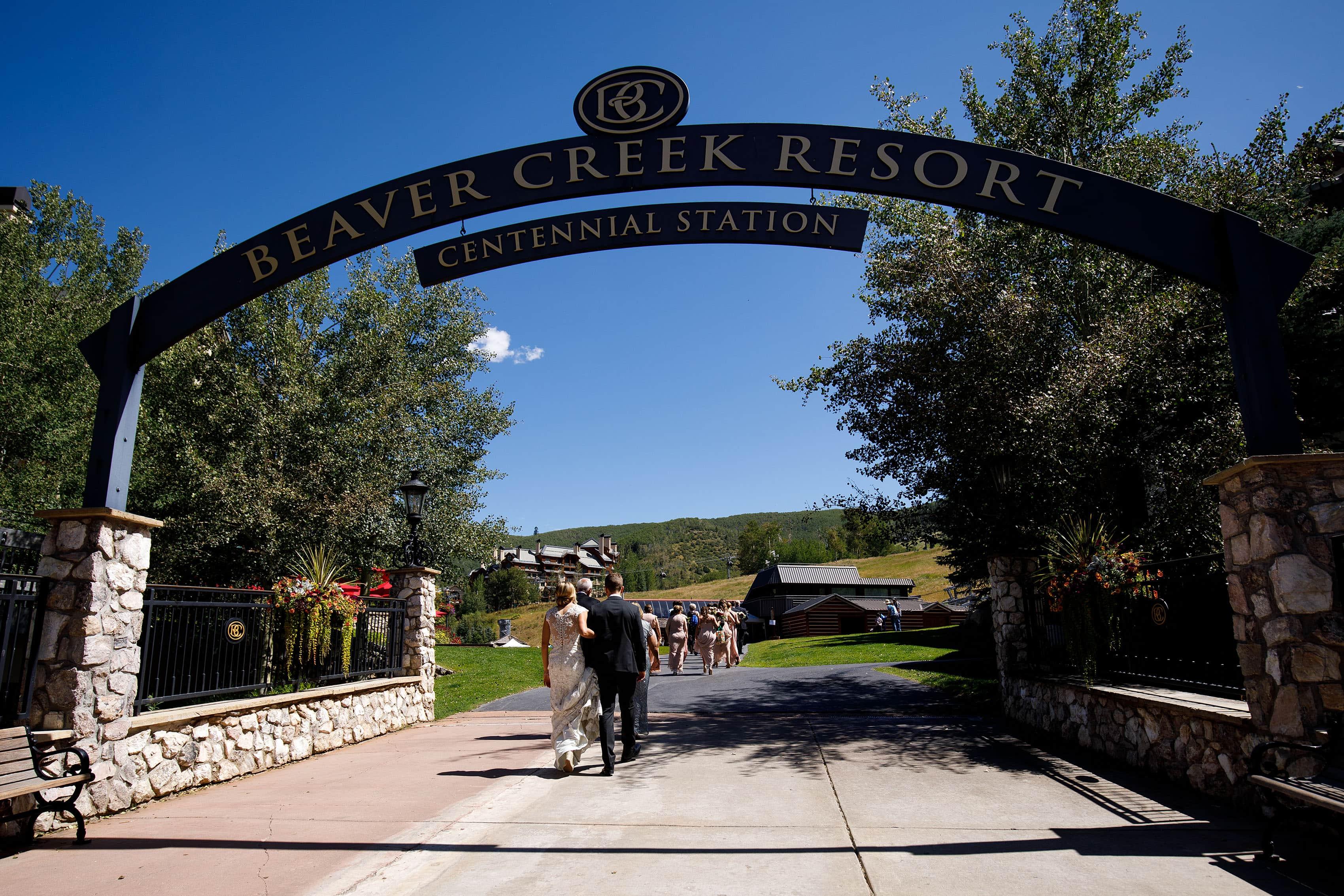 Bride and Groom walk near Centennial Station at Beaver Creek Resort