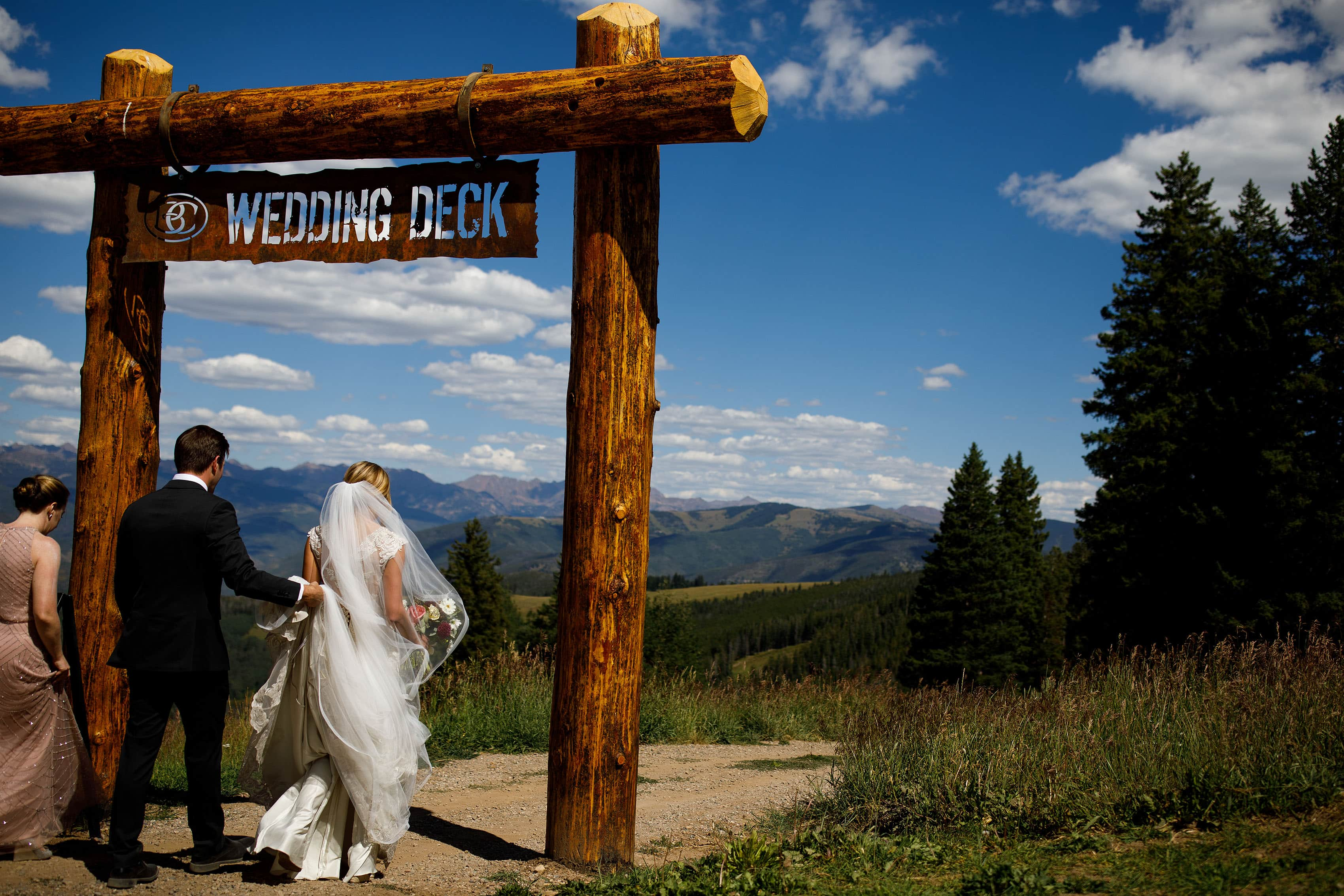 Bride walks down to the wedding deck at Beaver Creek