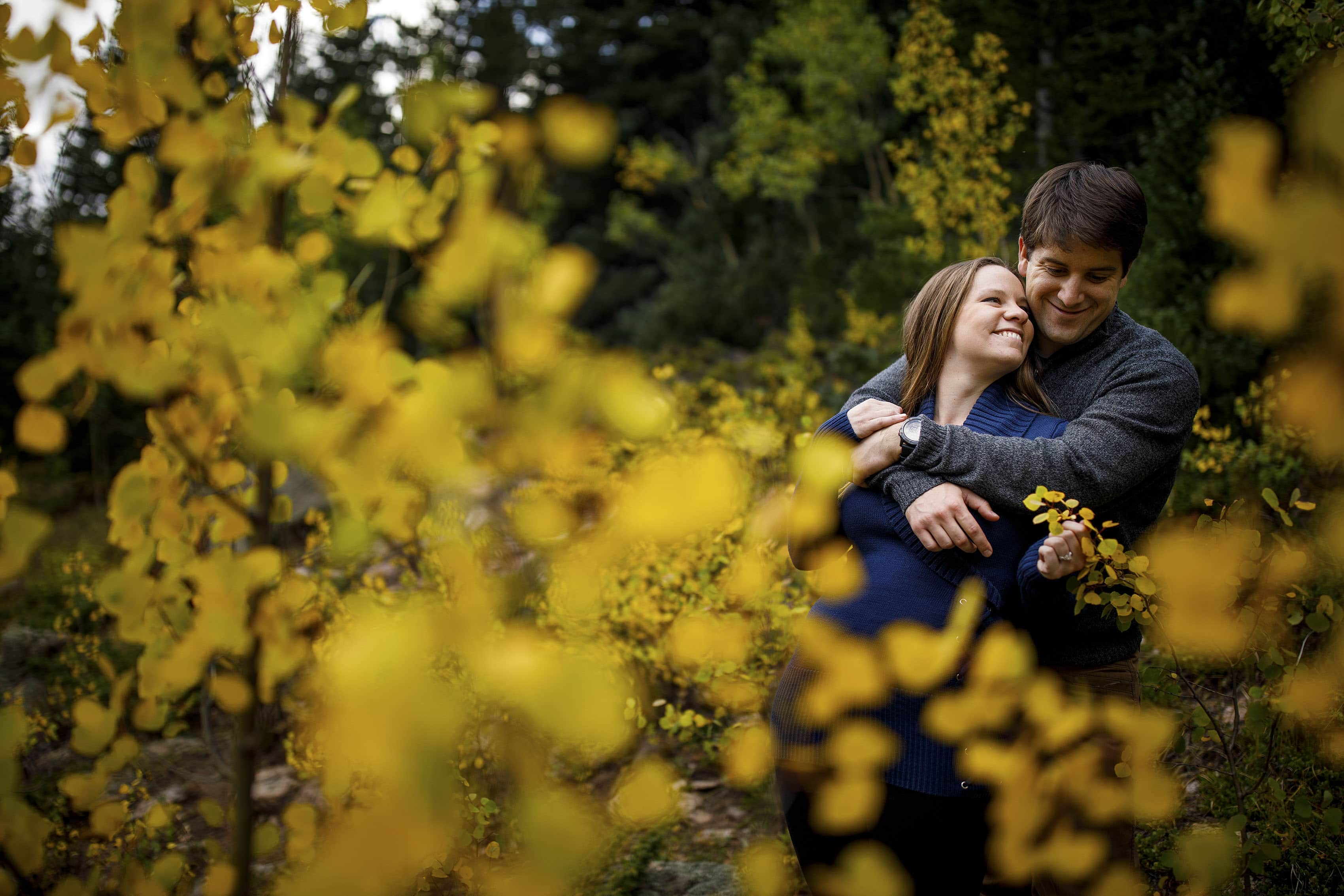 A couple poses during their fall colors engagement session