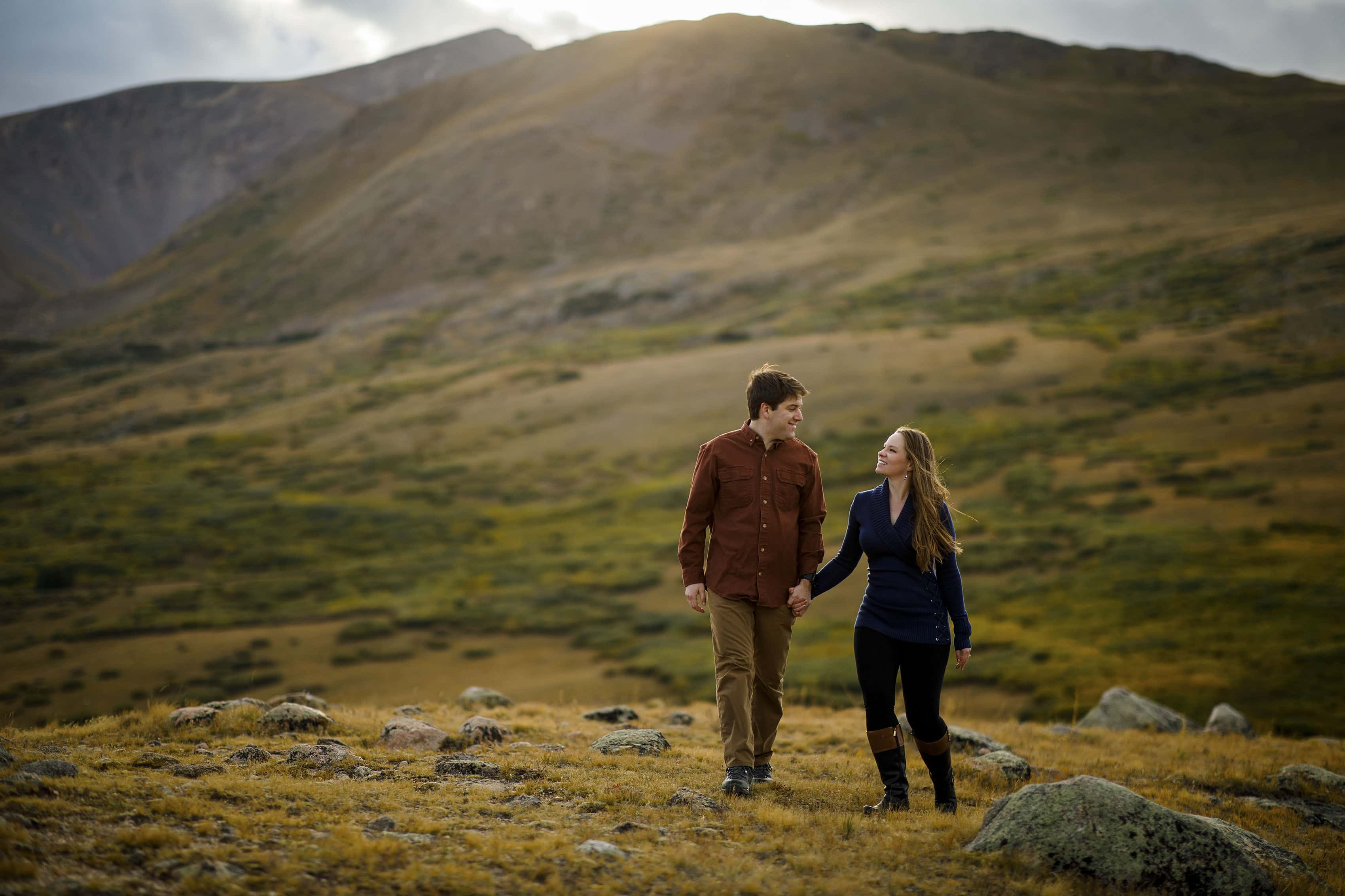 A couple walks on the tundra at Guanella Pass