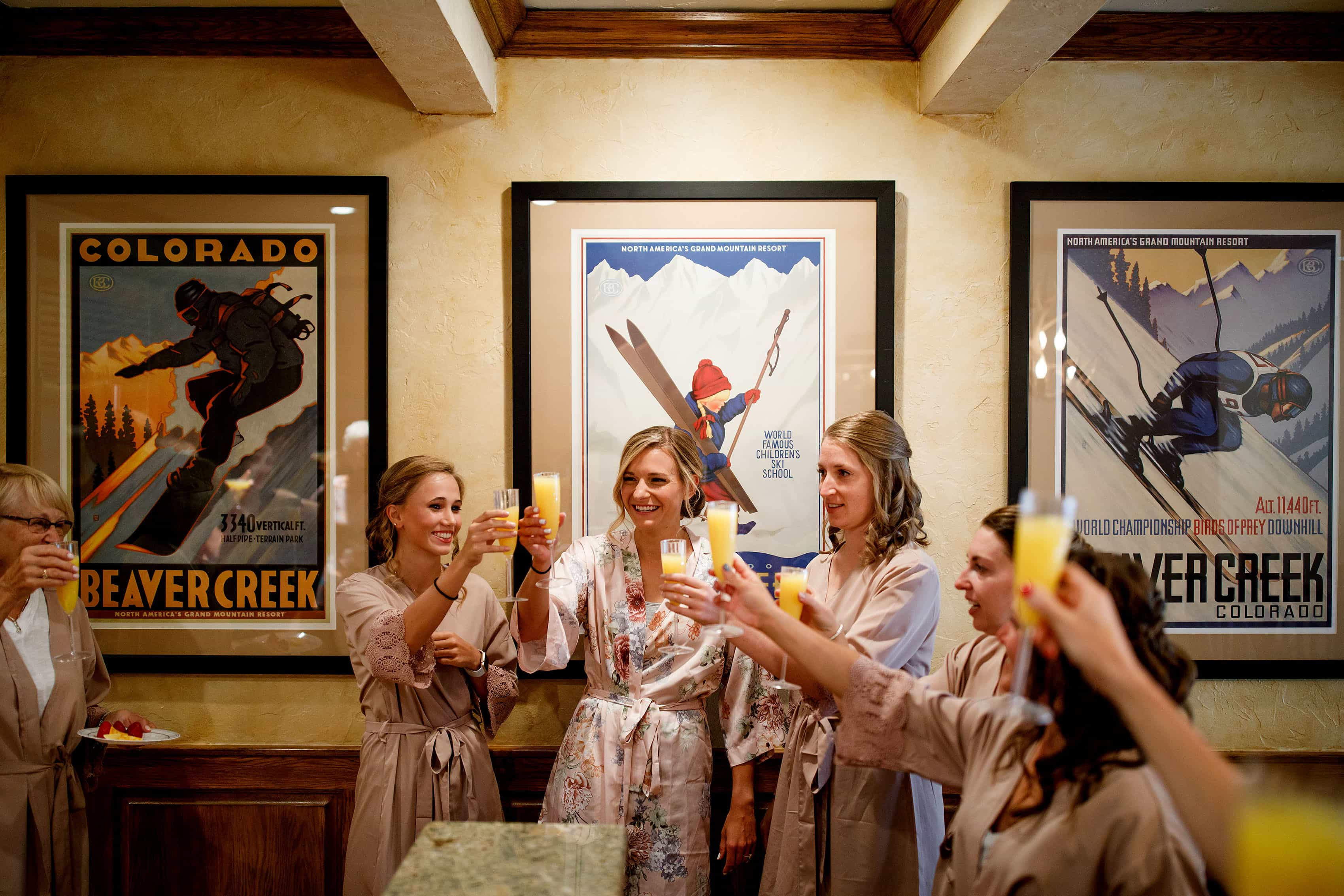 Bridal party toasts in the condo in Beaver Creek