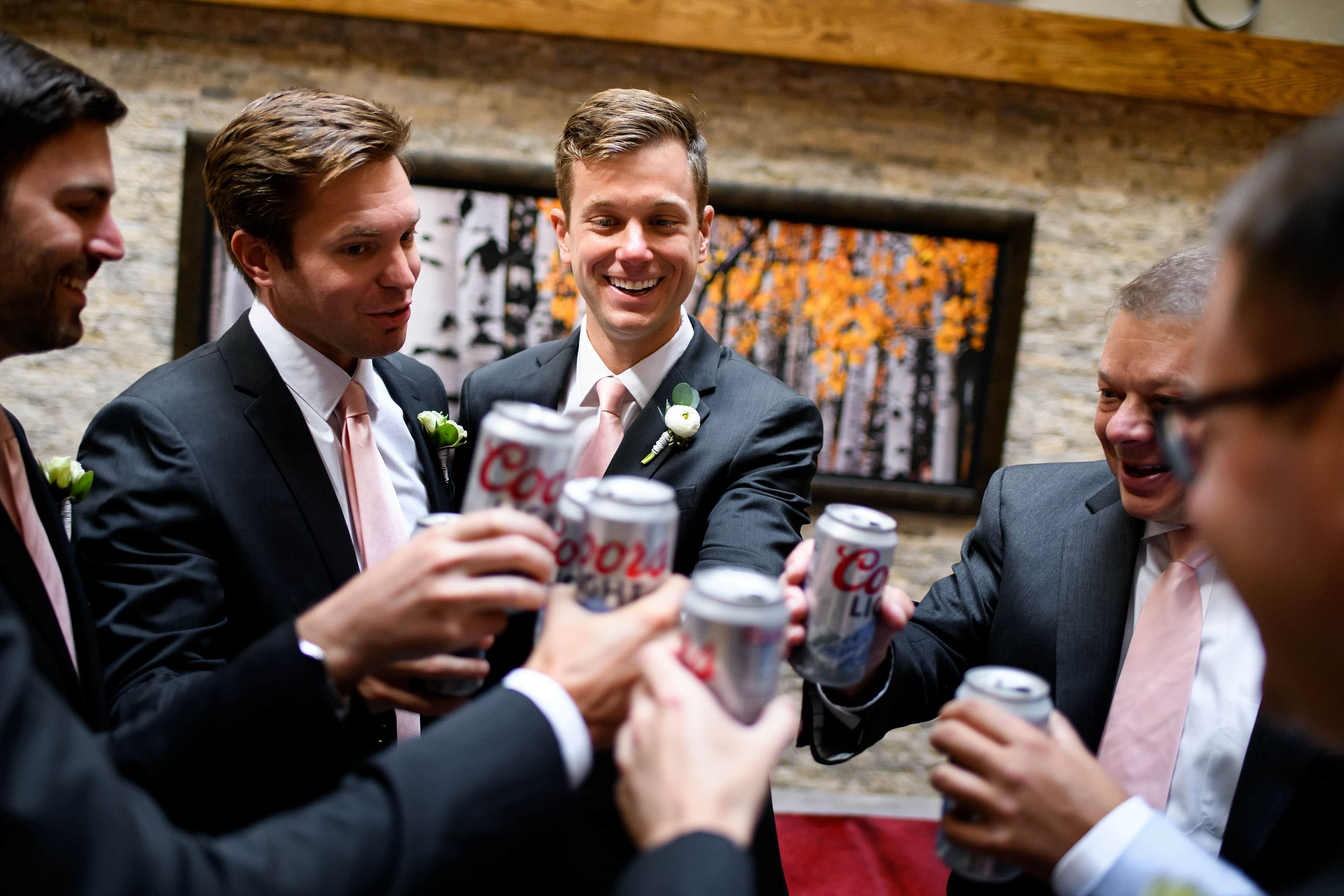 Groomsmen toast Coors Light on the wedding day