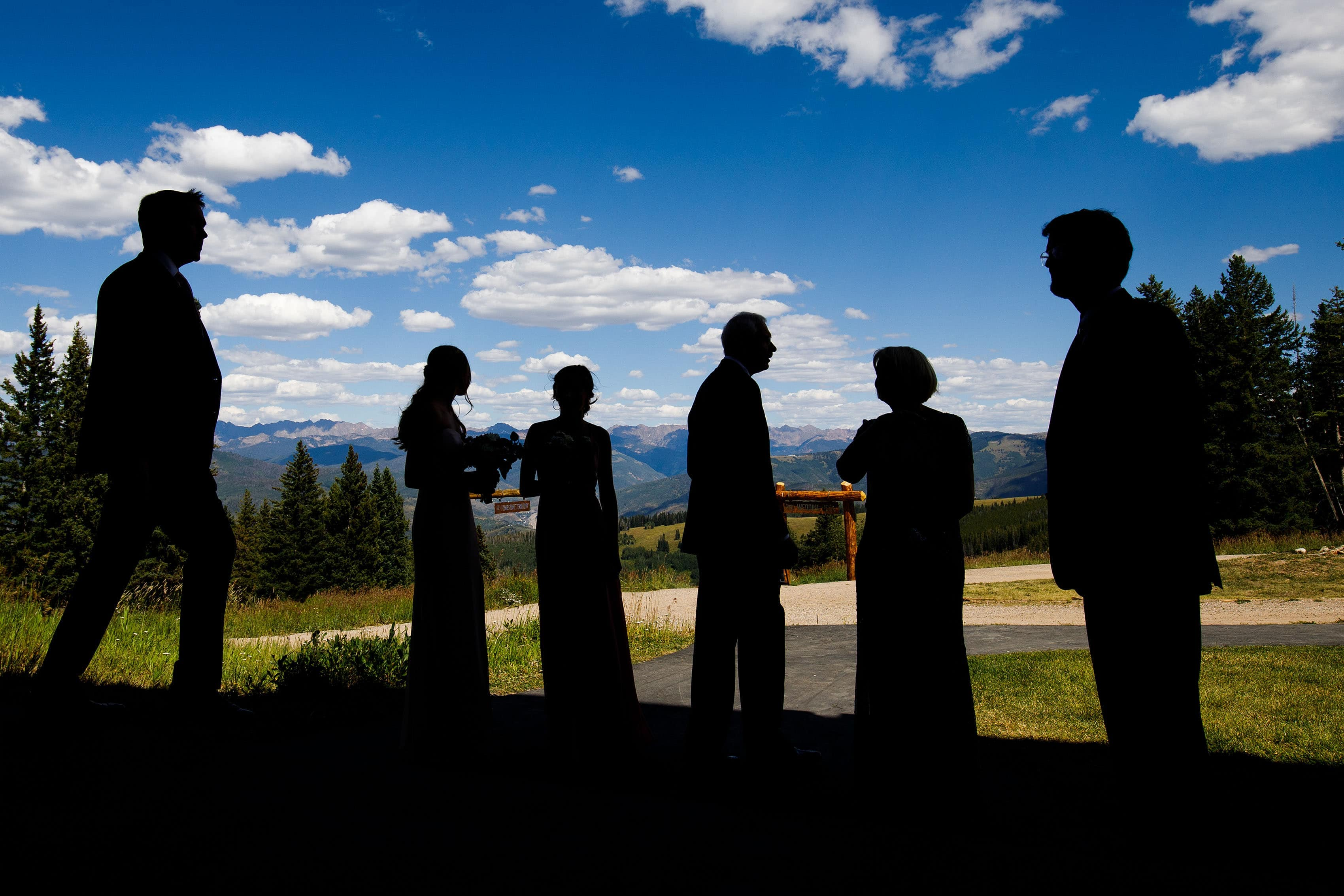 Wedding guests silhouetted at Solitude Station in Beaver Creek