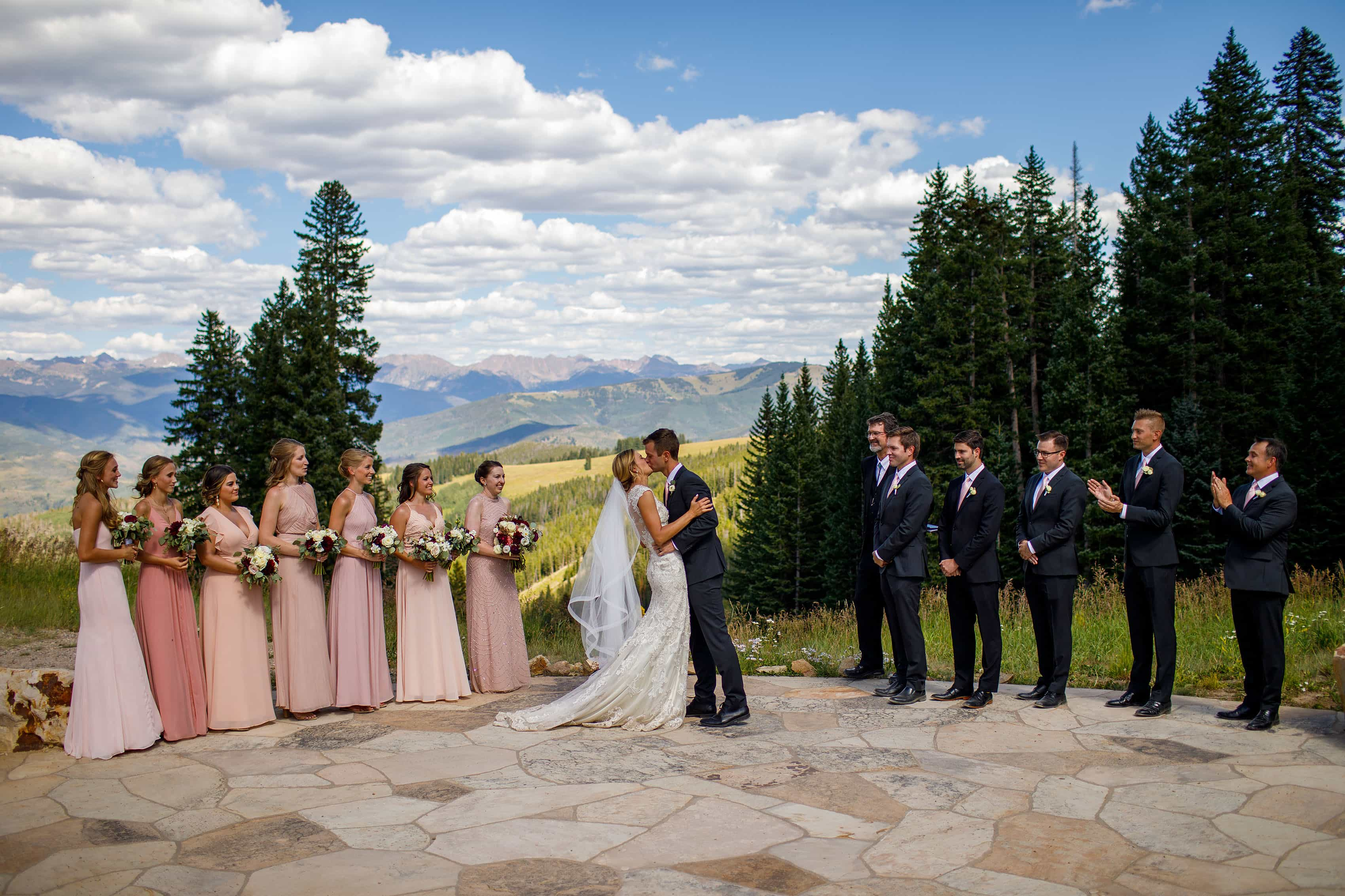 Bride and groom kiss during their mountain ceremony at Beaver Creek wedding deck