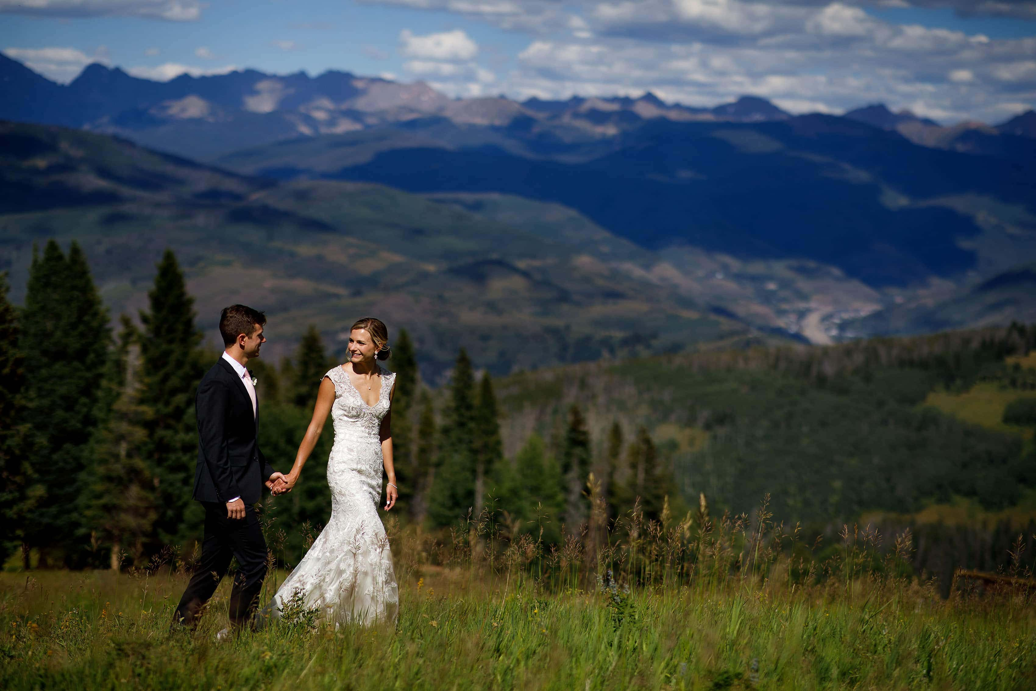Melissa and Drew walk together atop Beaver Creek mountain