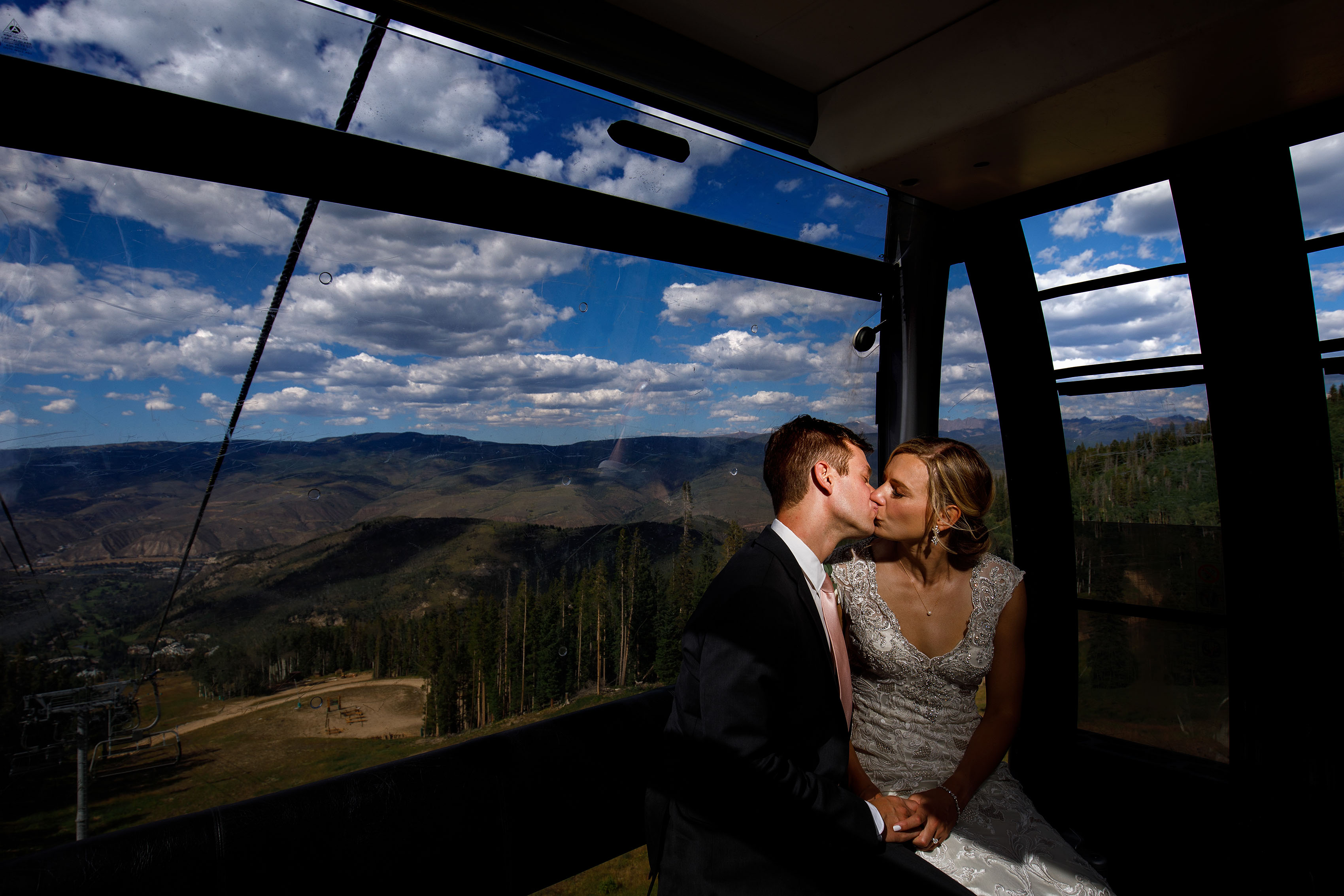 Melissa and Drew share a kiss in the Centennial Express gondola