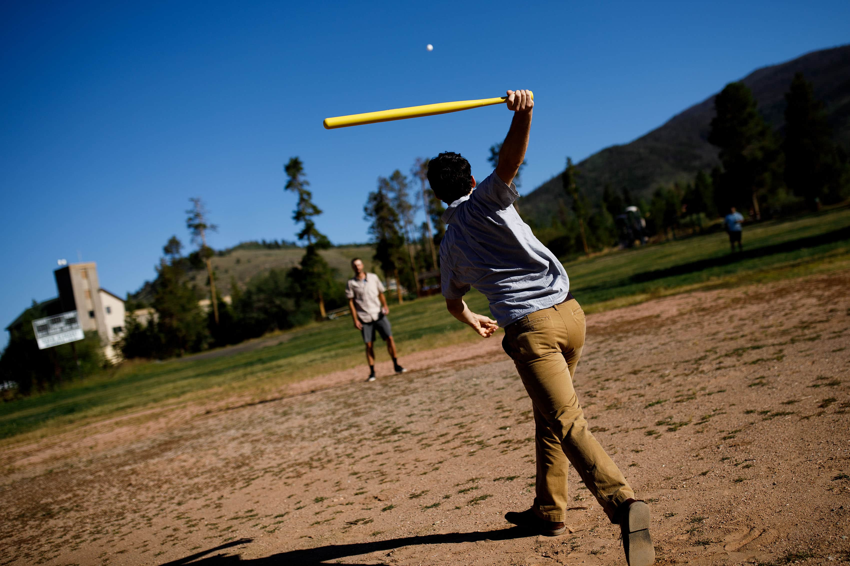 The groom plays wiffle ball with friends in Dillon