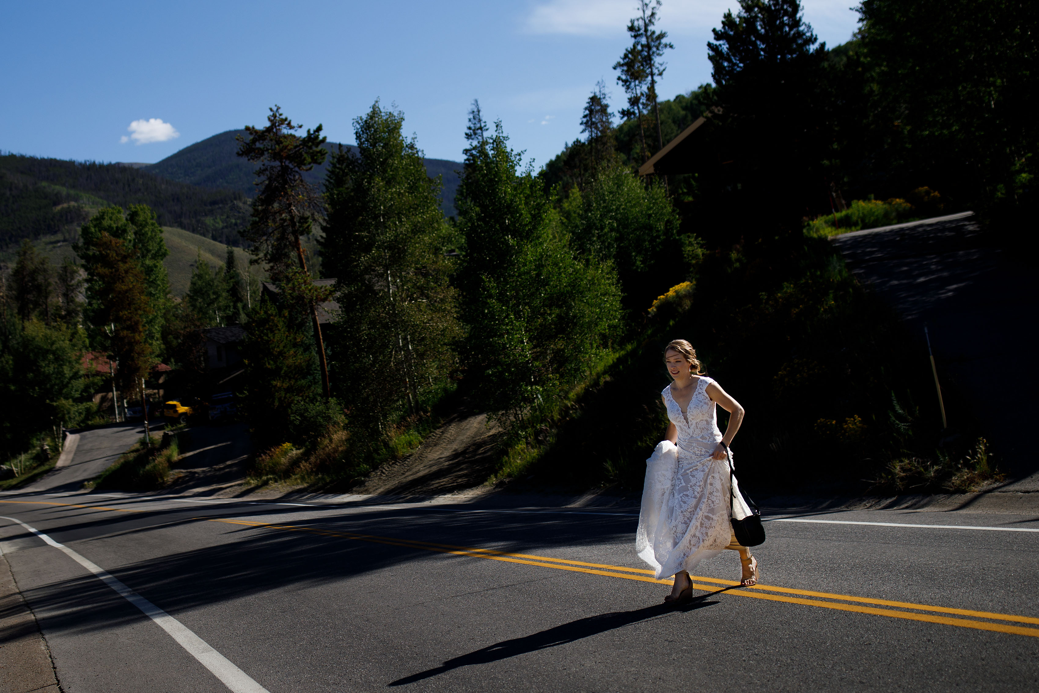Carissa crosses the street on her wedding day