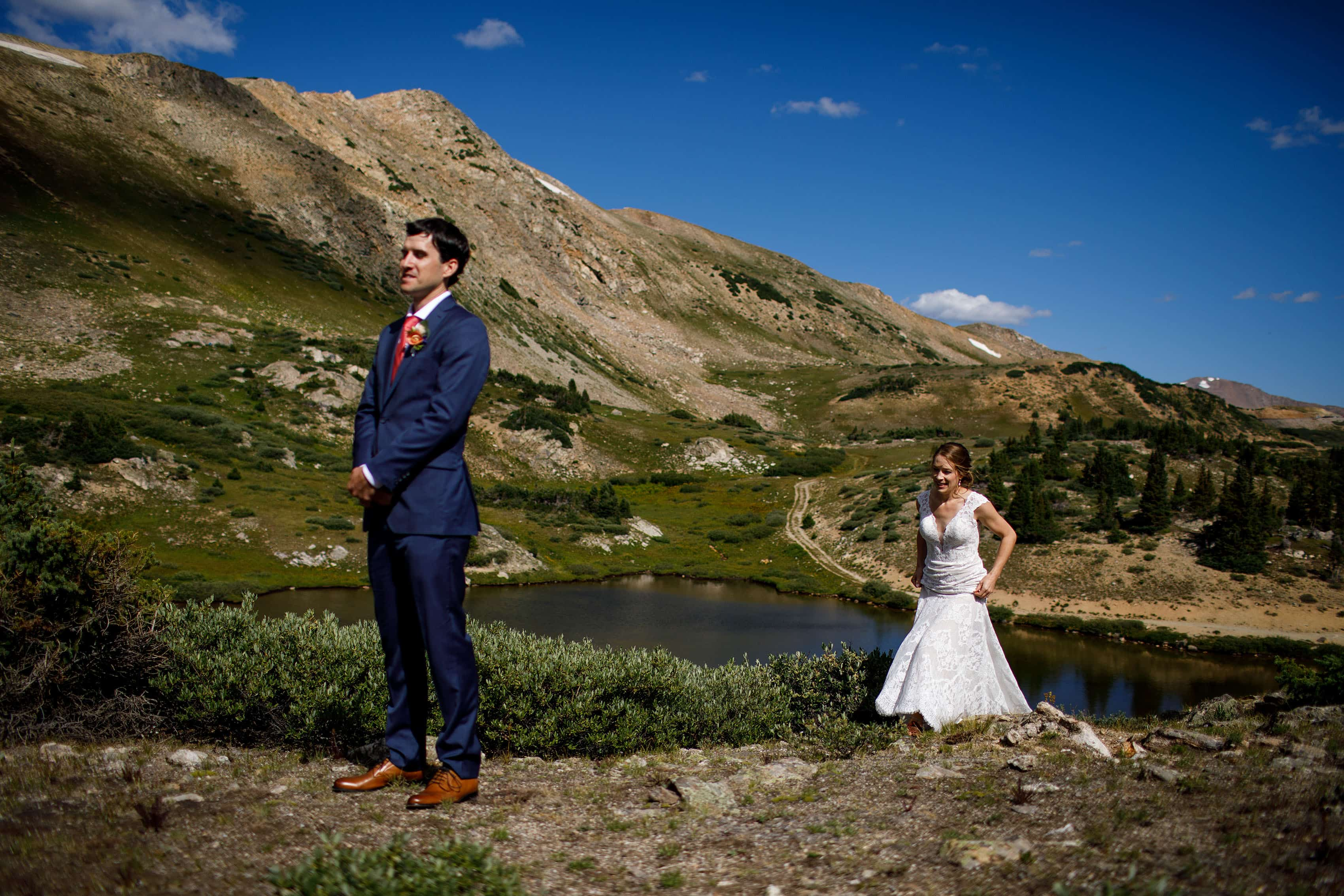 Carissa walks up a hill to Kyle during their first look on Loveland Pass