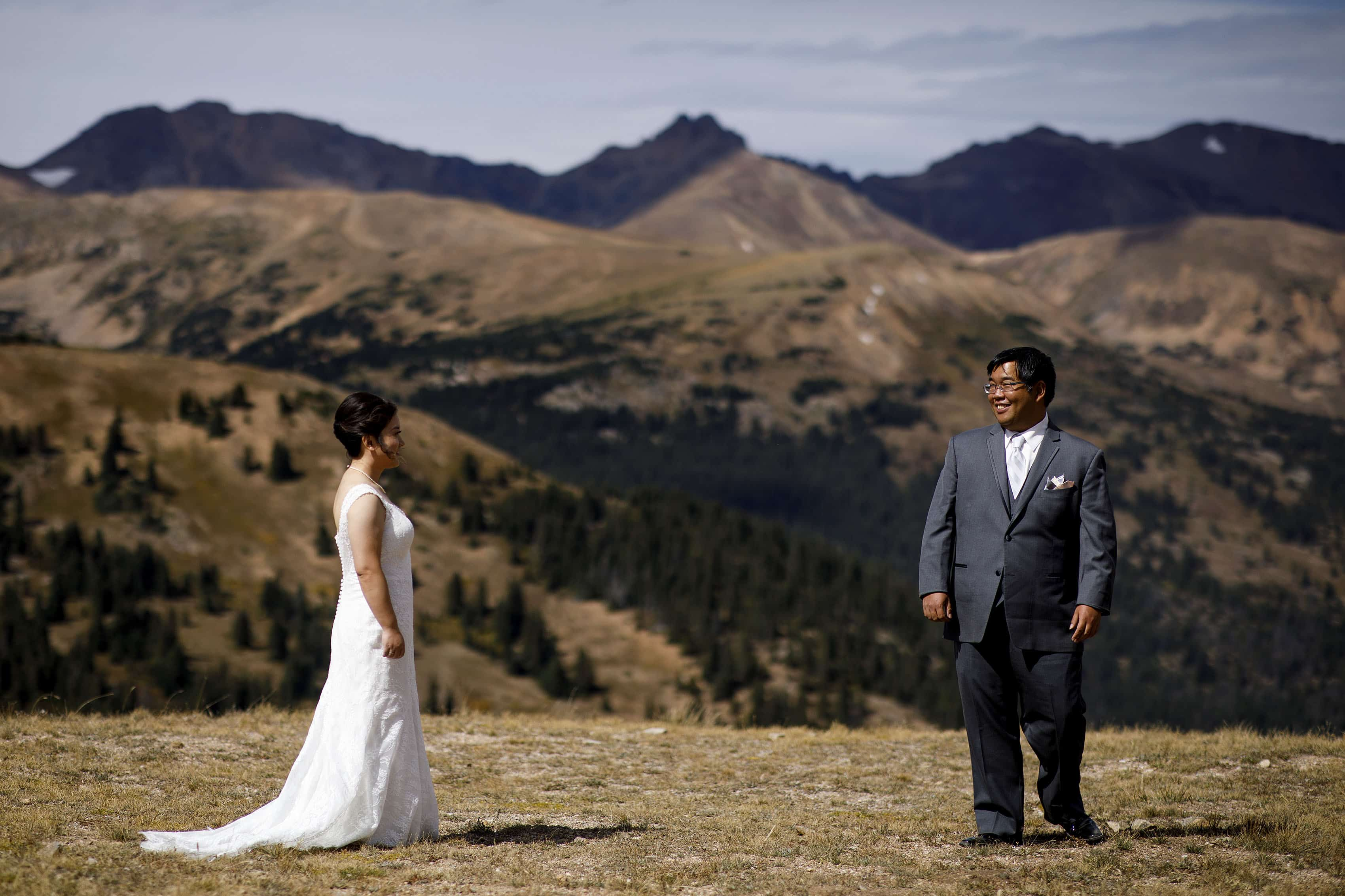 Xinya and David's first look on the top of Loveland Pass before their mountain wedding at Arapahoe Basin