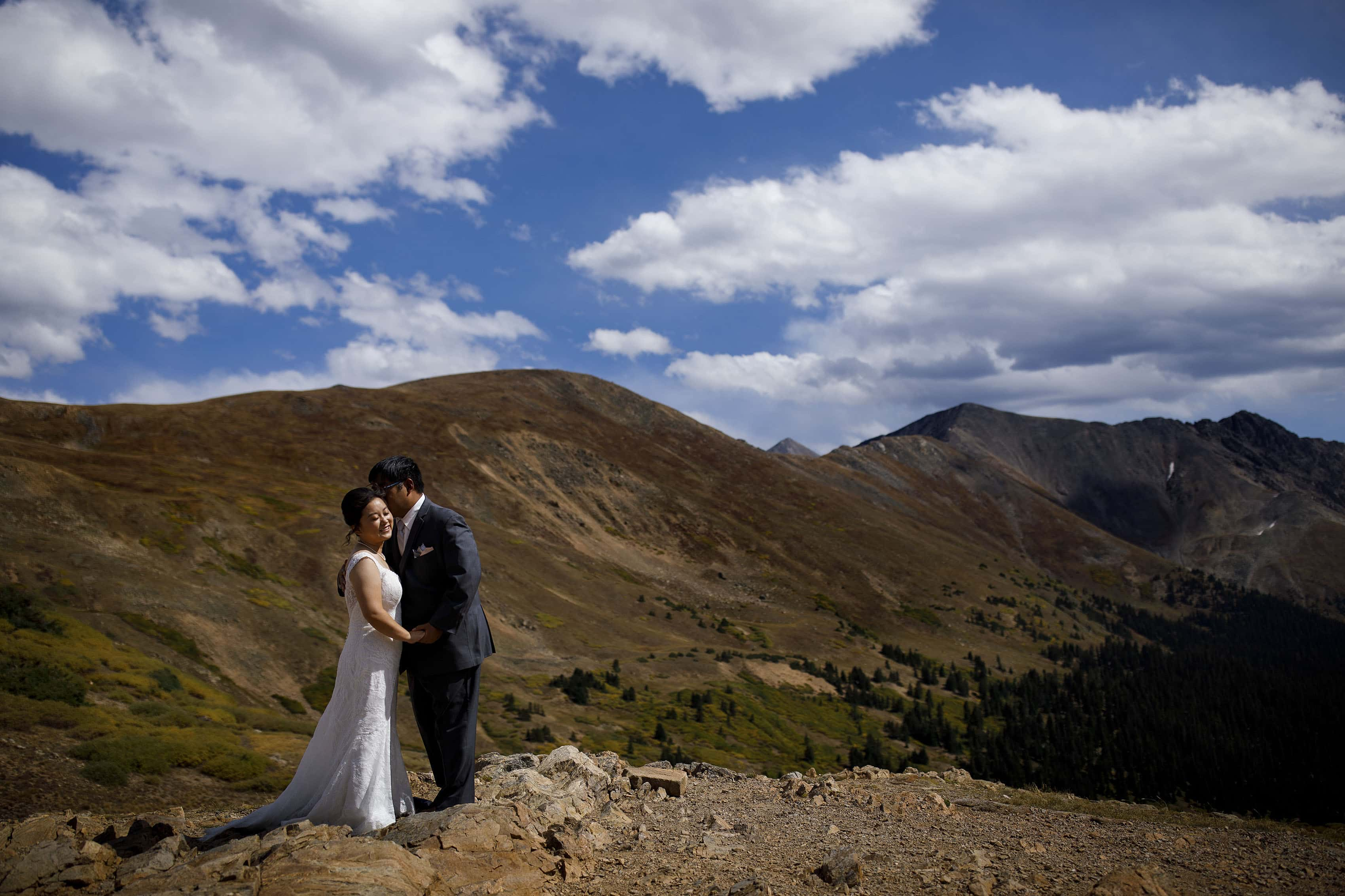 David kisses Xinya atop Loveland Pass on their wedding day