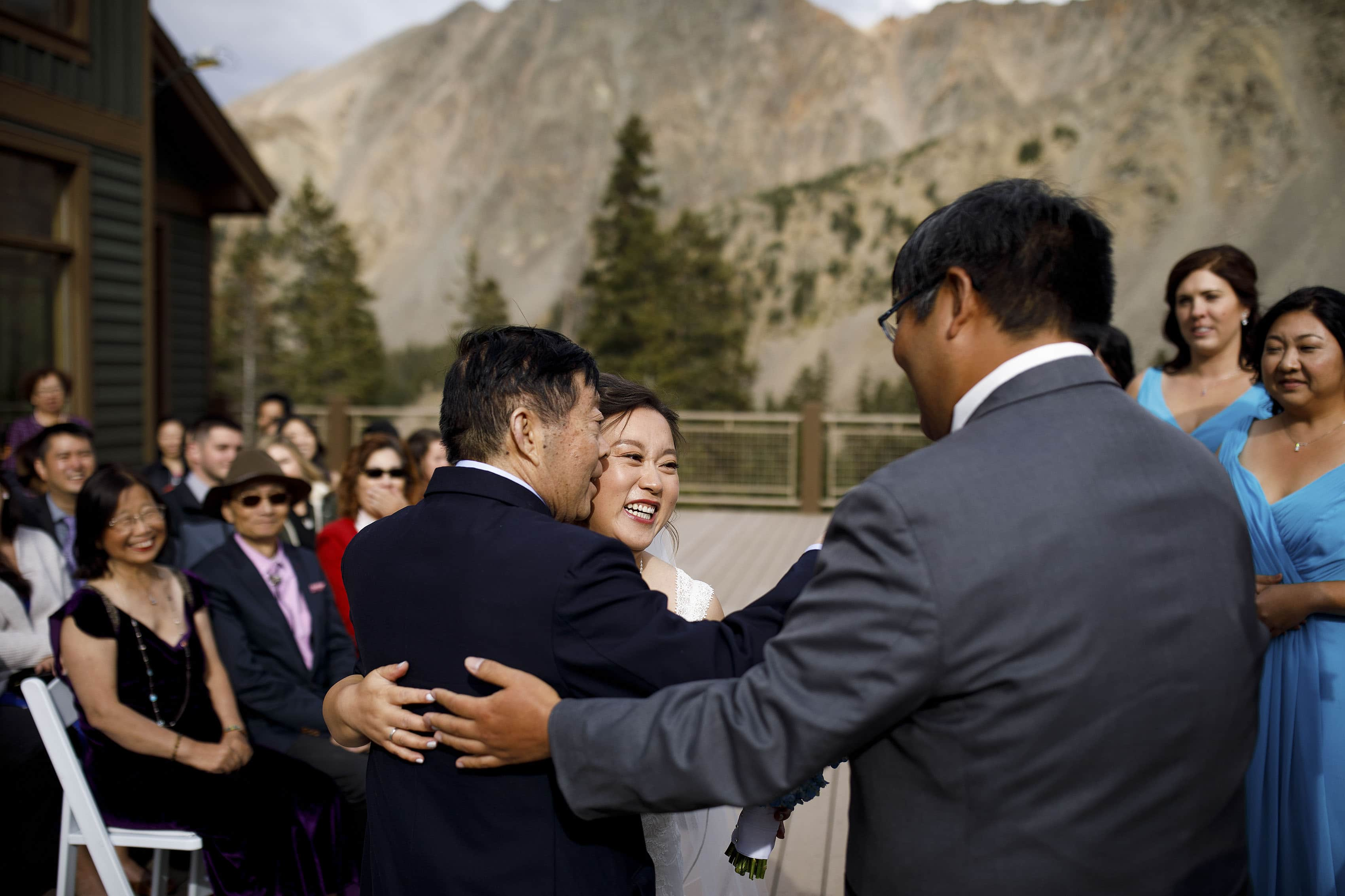 Xinya hugs her father during the wedding ceremony