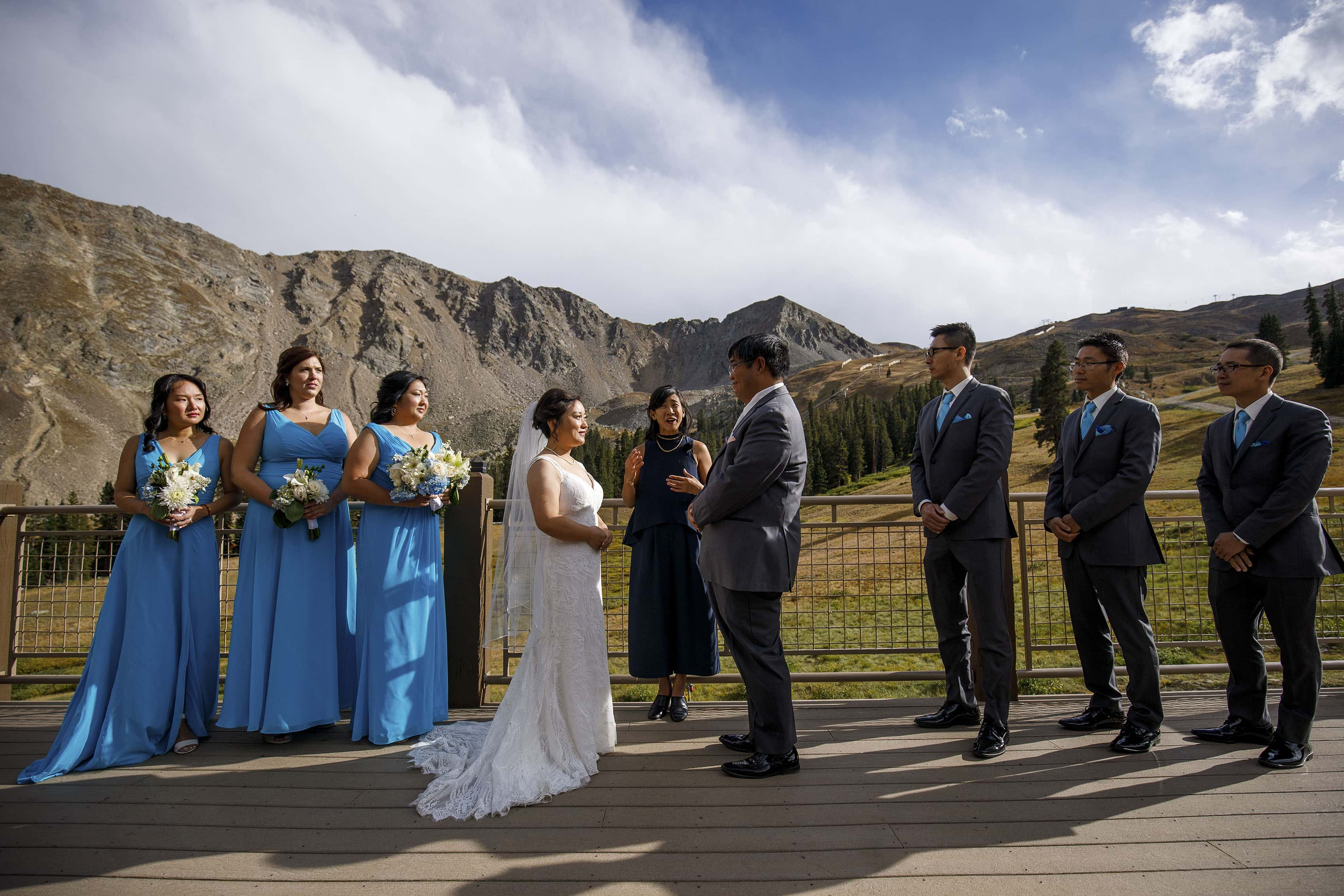 Xinya and David's wedding ceremony at Arapahoe Basin's Black Mountain Lodge deck