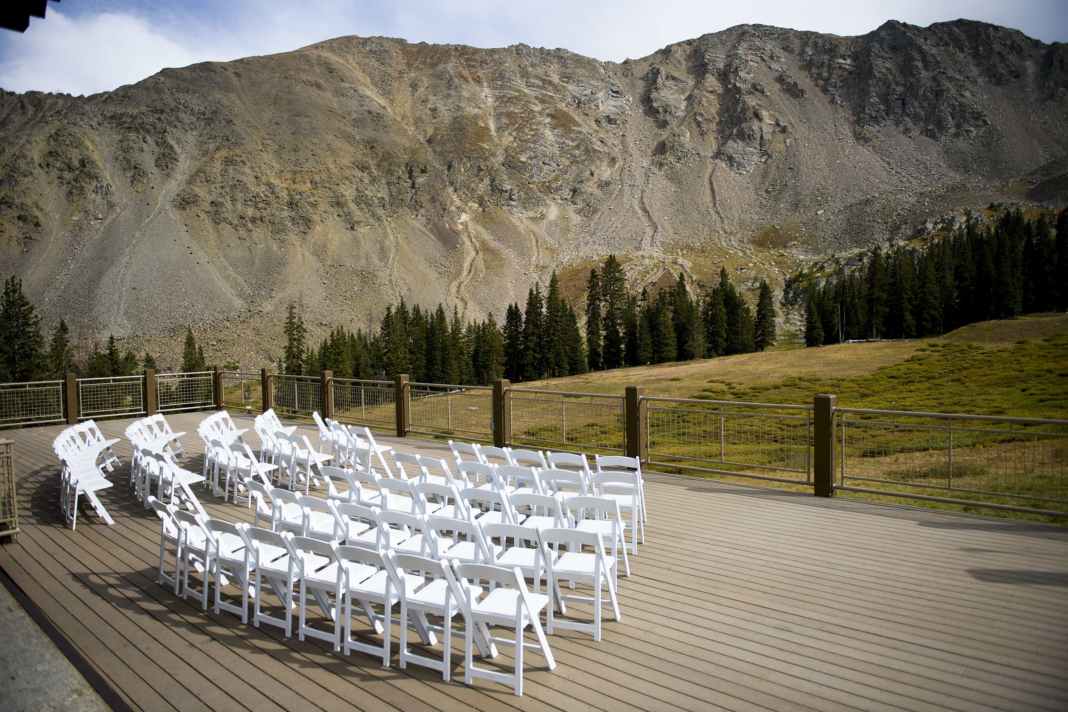 Wedding deck ceremony setup at Arapahoe Basin's Black Mountain Lodge