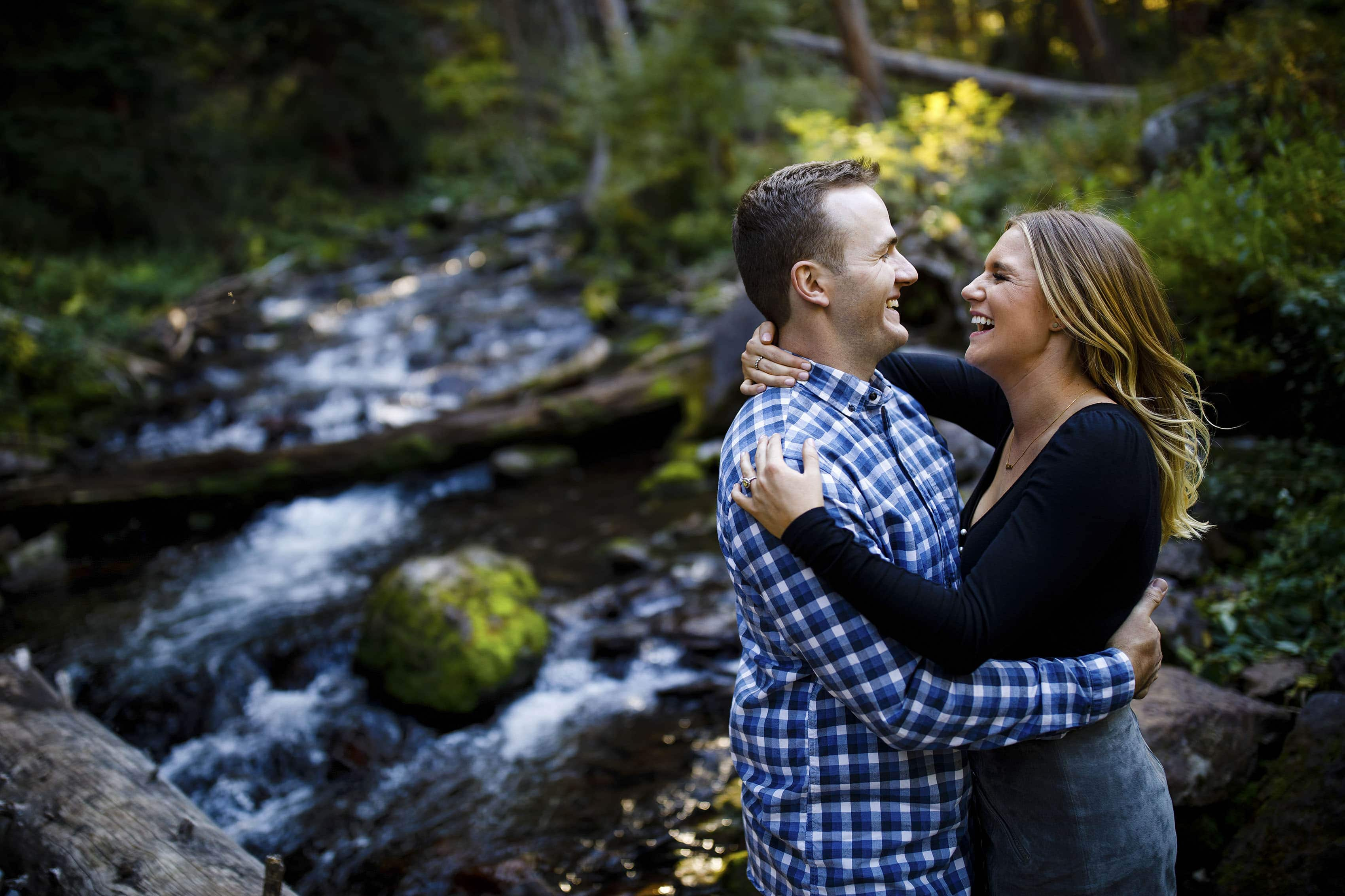 Drew and Mel share a laugh near West Maroon Creek in Aspen
