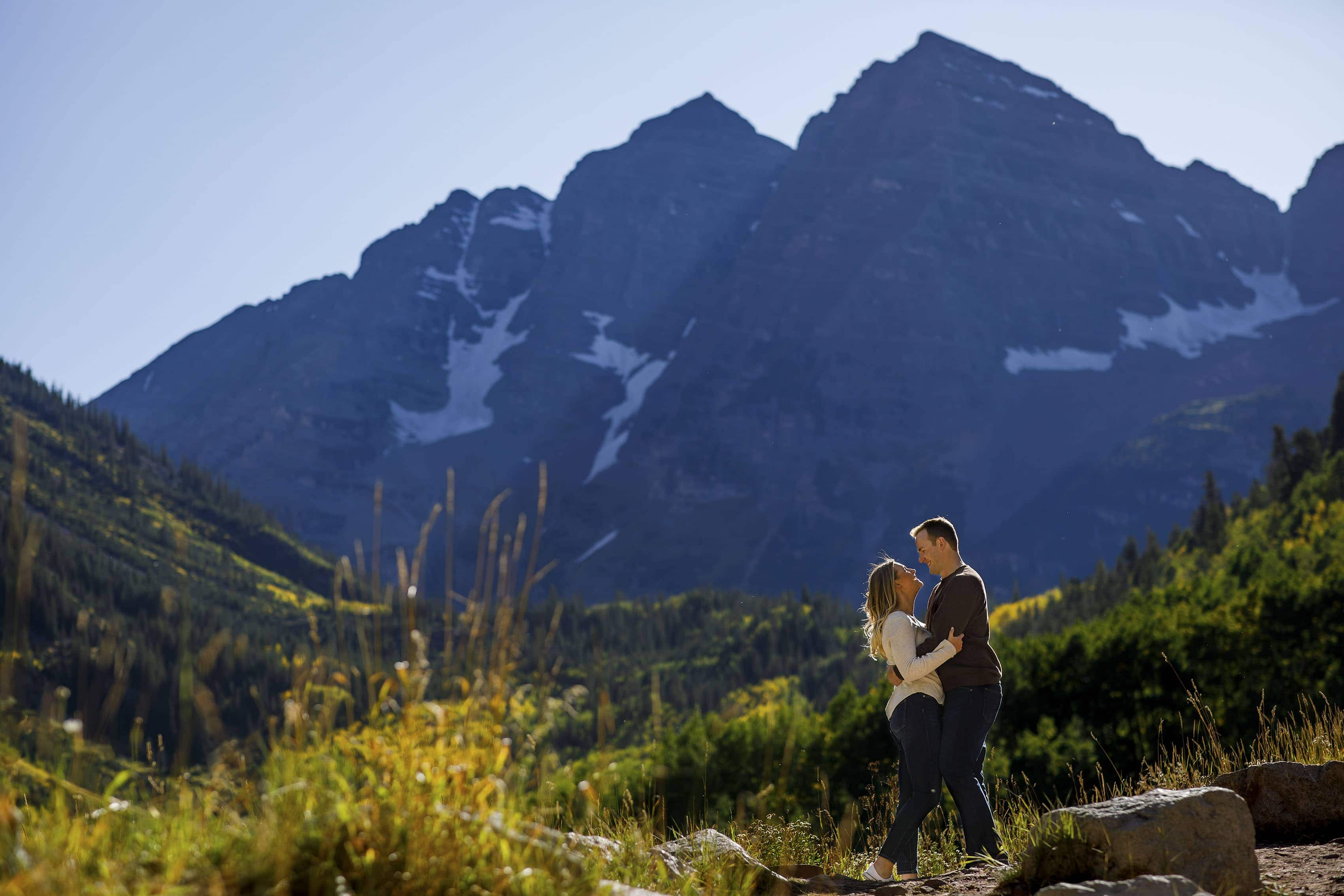 A couple poses at the Maroon Bells in Aspen