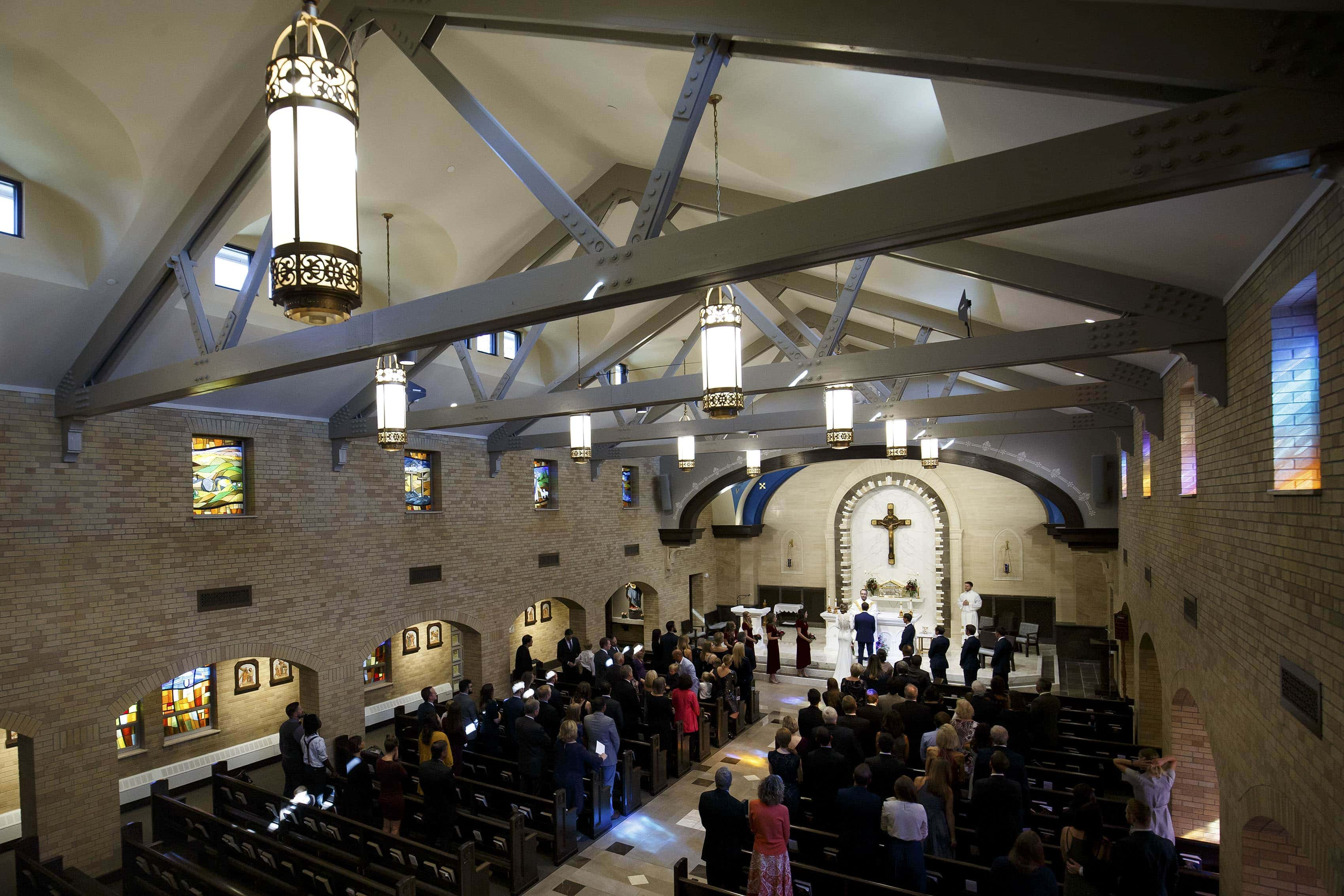 A wedding ceremony inside the newly remodeled Our Lady of Lourdes Catholic Church in Denver