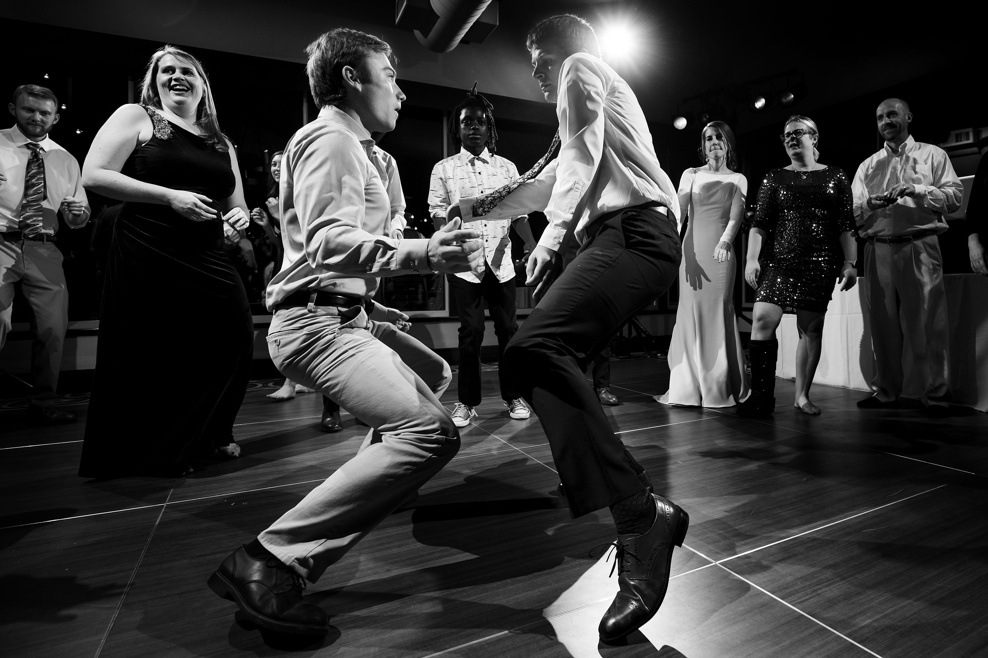 Guests dance at a wedding at The Vista at Applewood Golf Course