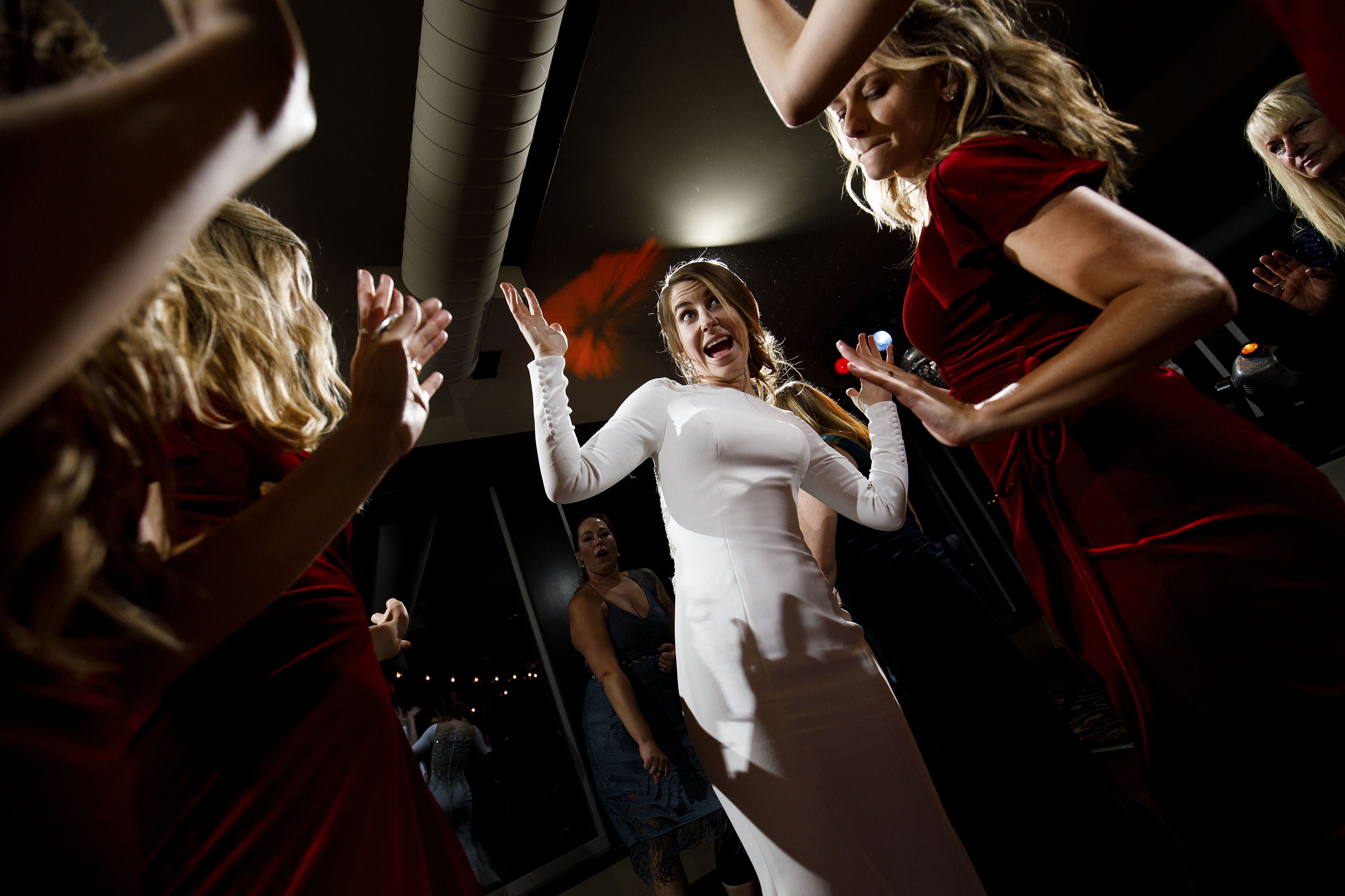 The bride dances with guests dance at a wedding at The Vista at Applewood Golf Course