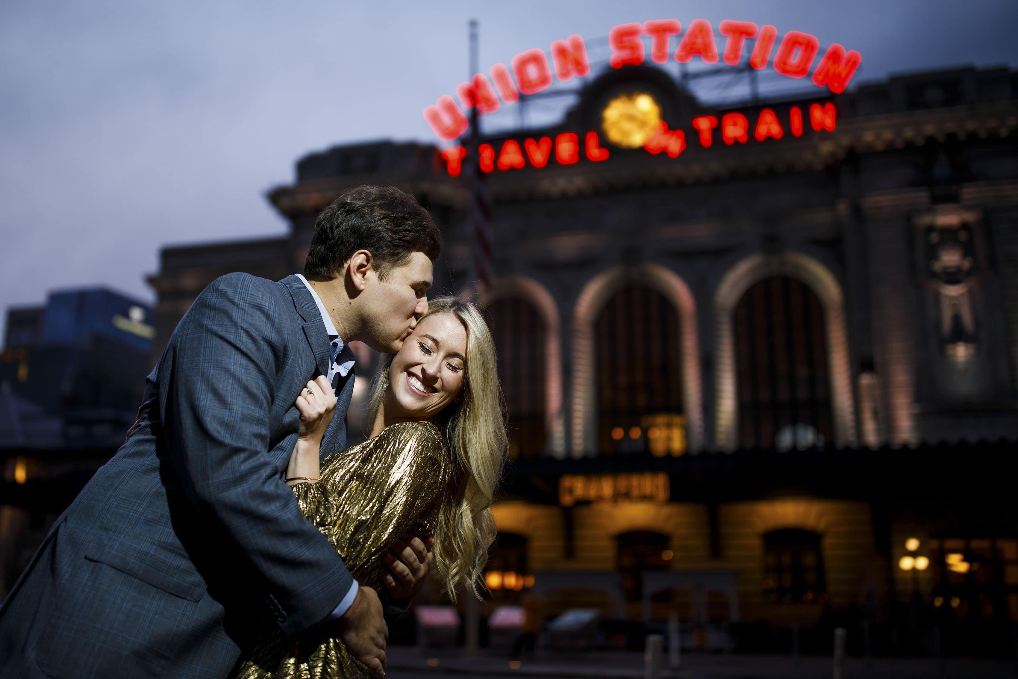 Alex kisses Sierra outside Denver's Union Station as they celebrate their recent engagement
