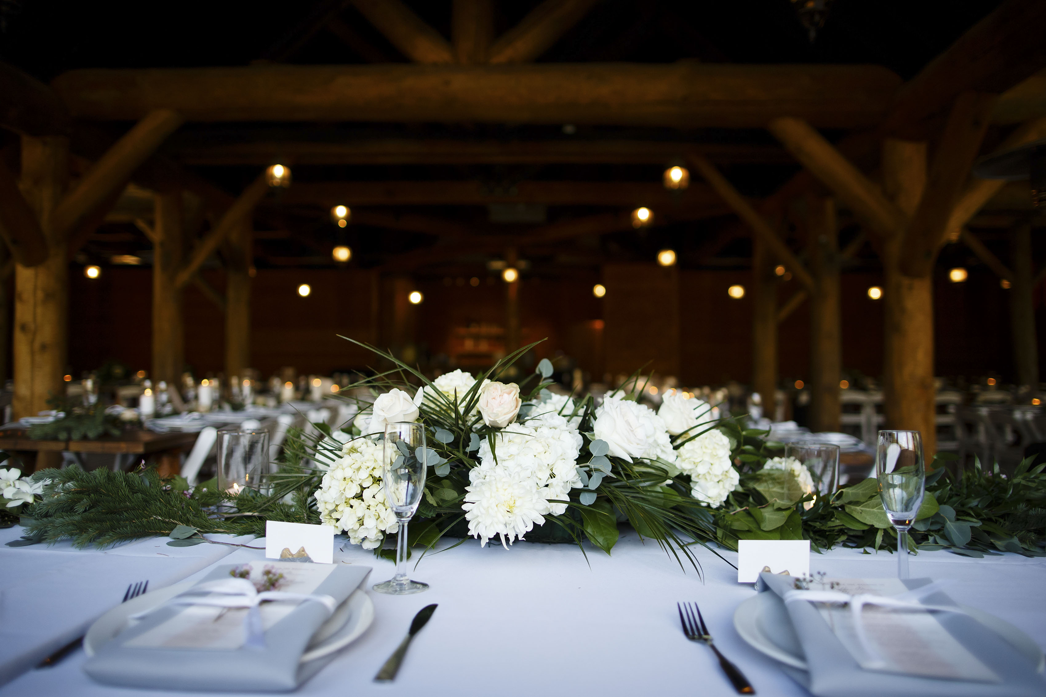 Flowers on a table during a Piney River Ranch wedding