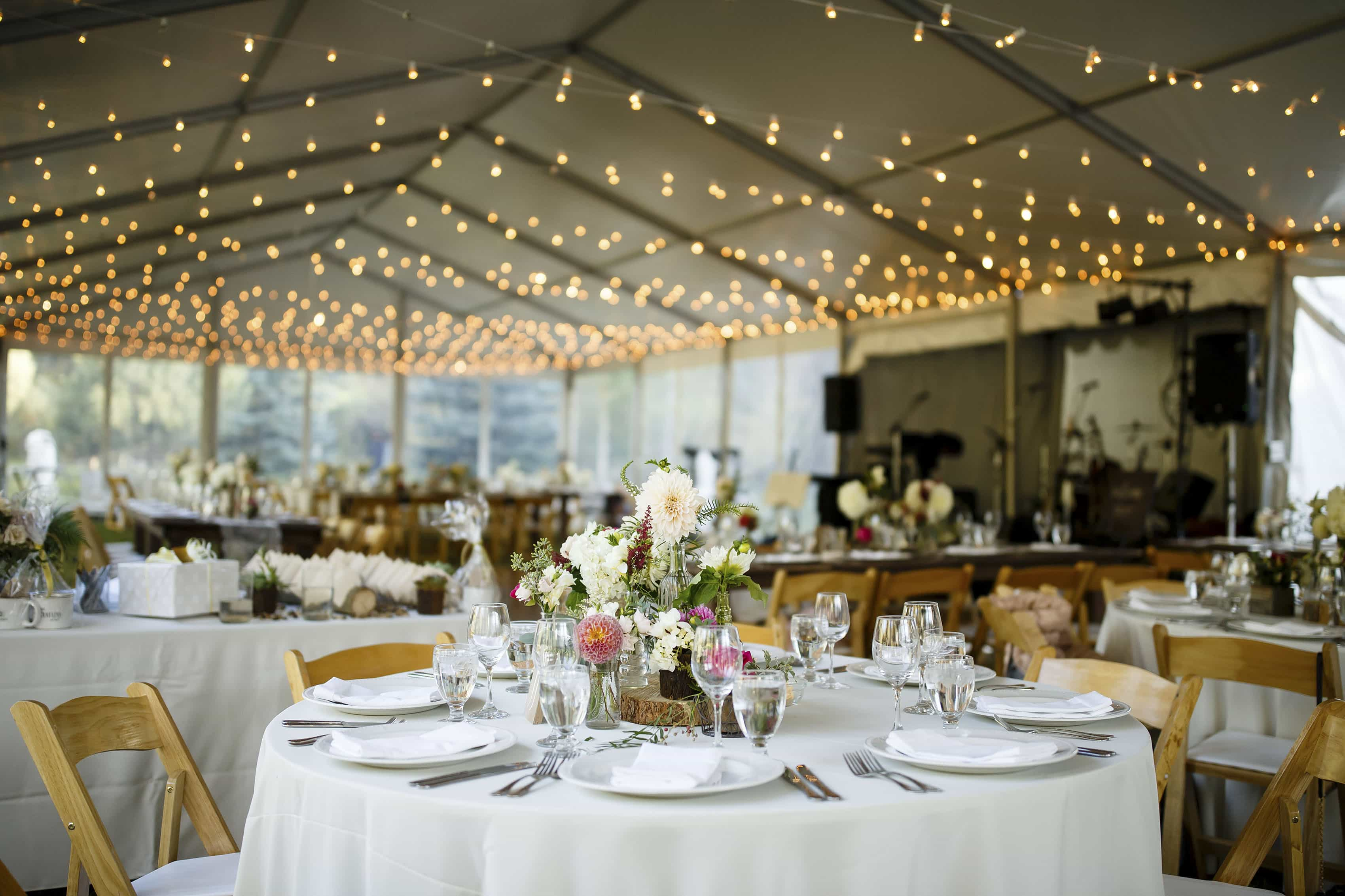 Wedding reception setup with market lights at Snowmass Cottages