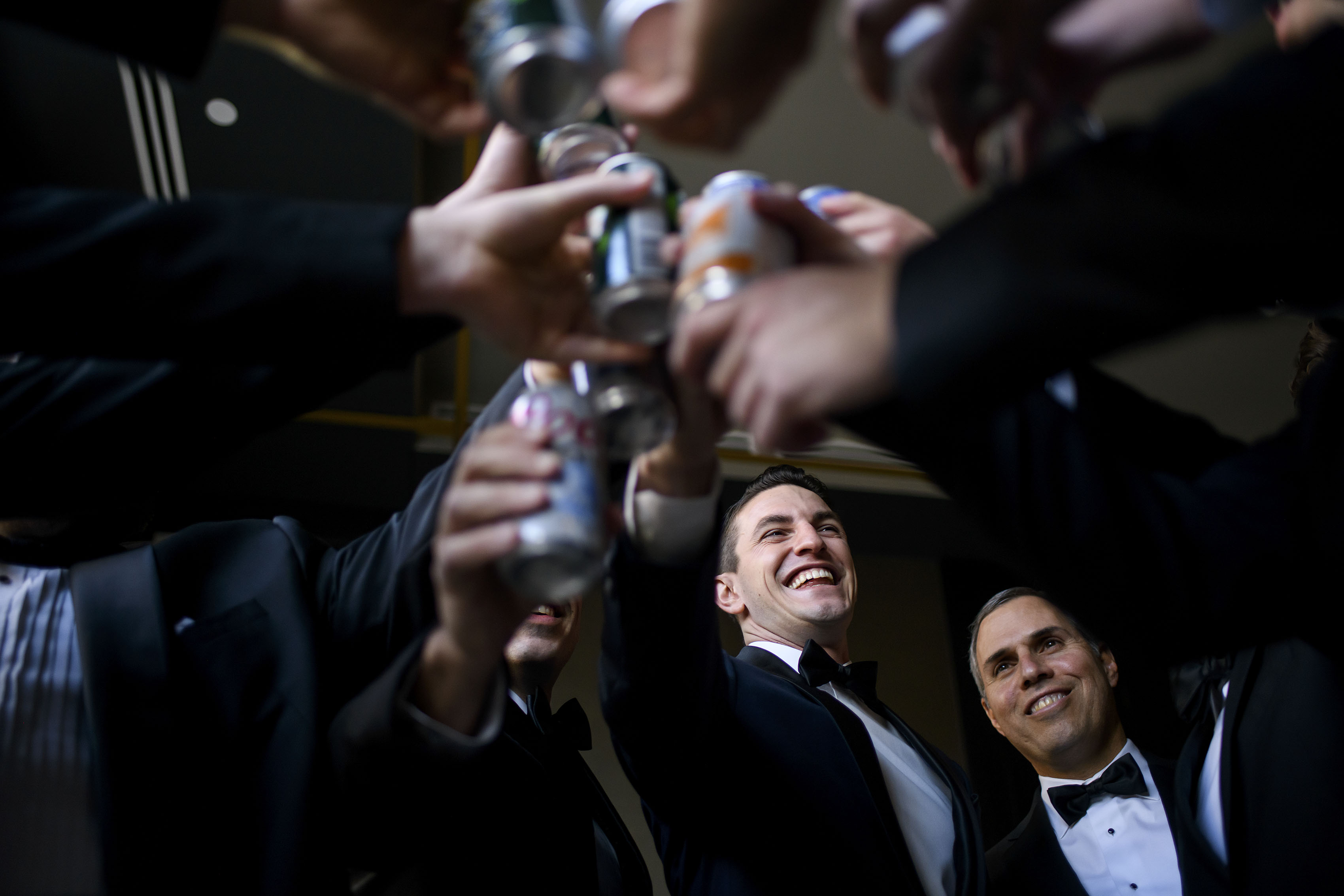Alex toasts with his groomsment