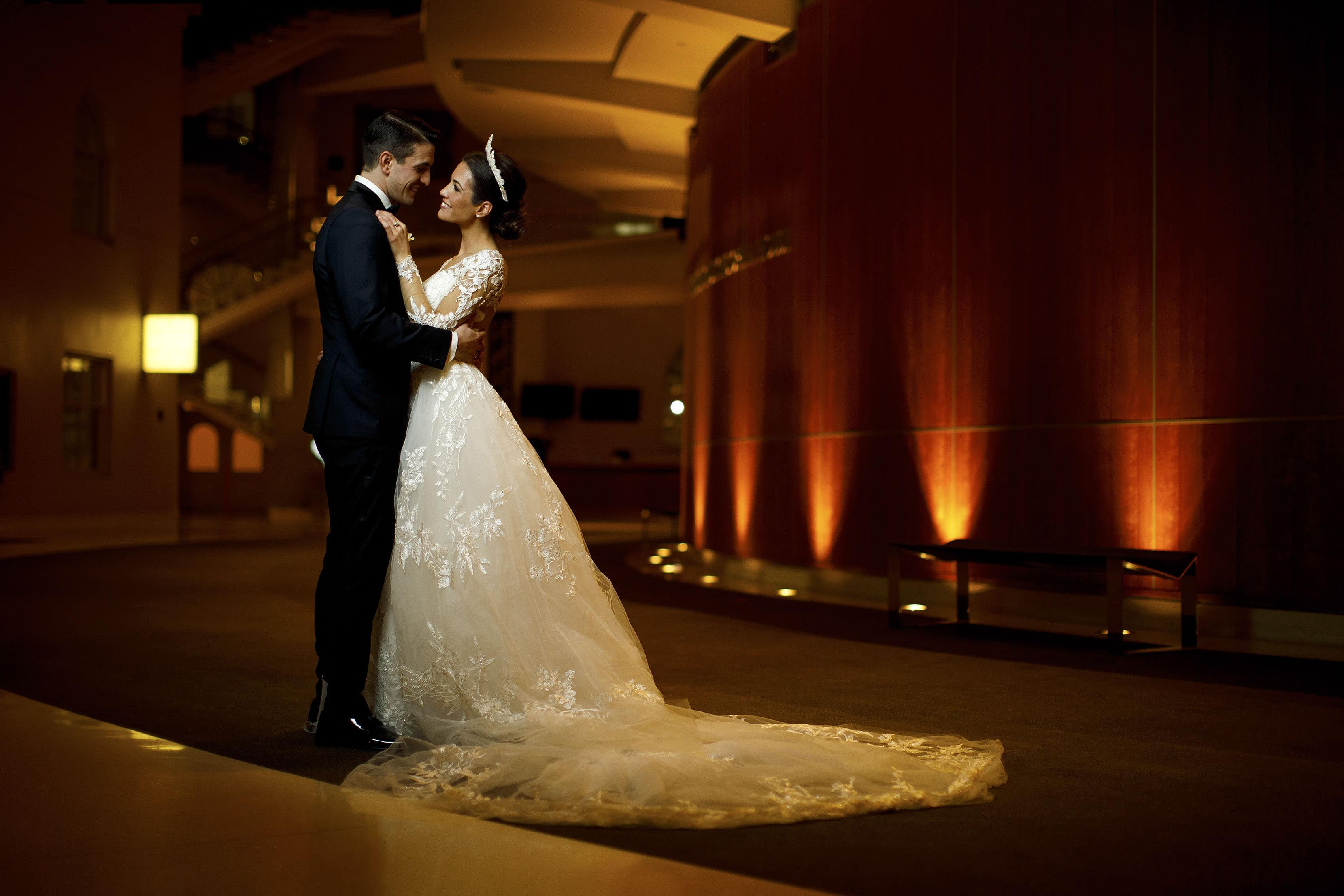 The newlyweds pose in the Ellie Caulkins Opera House Lobby at the Denver Center for the Performing Arts