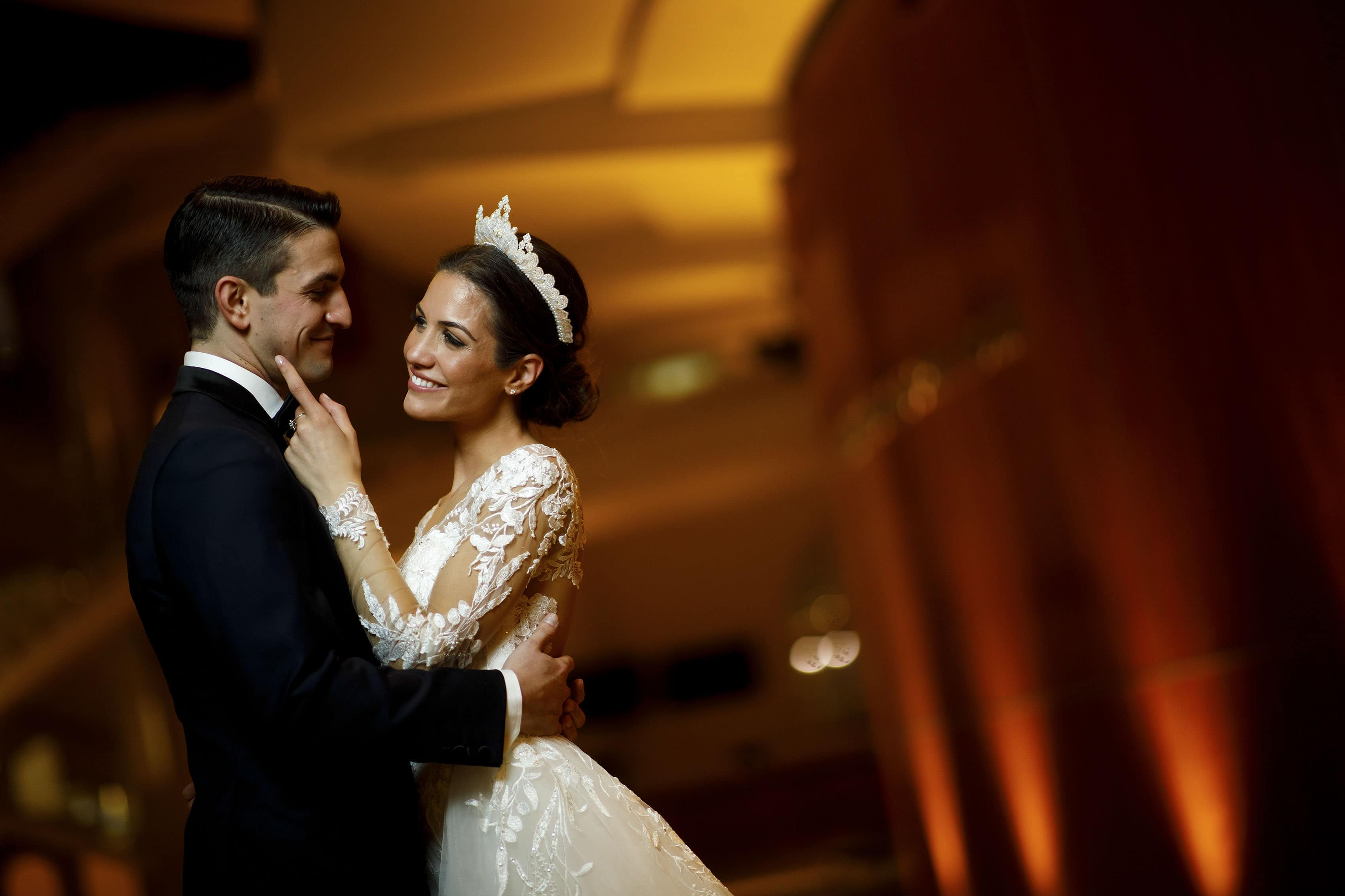 Ioanna and Alex share a moment together during their wedding day in the Ellie Caulkins Opera House Lobby at the Denver Center for the Performing Arts