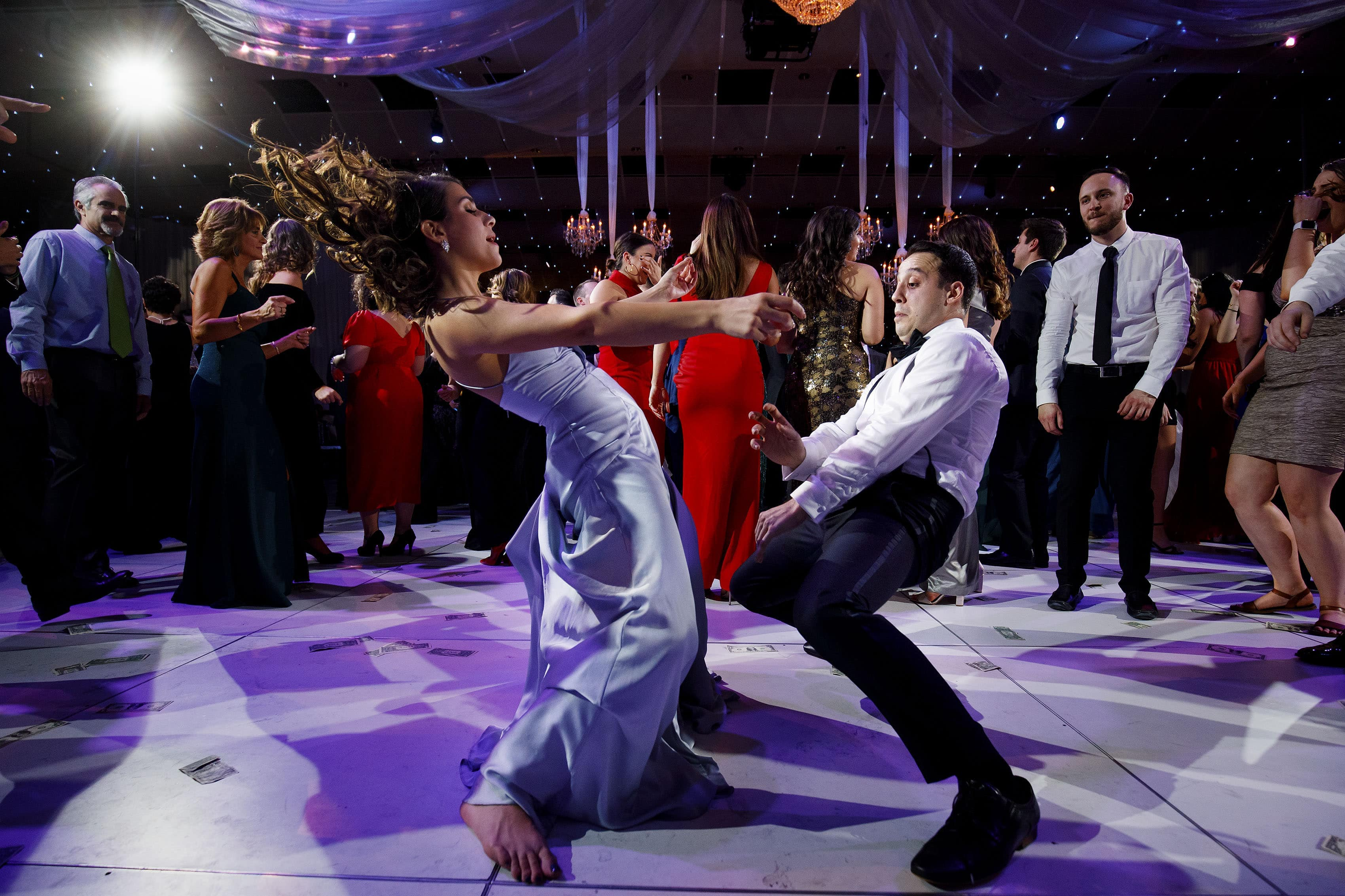 Guests dance during a wedding recetion at Seawell Ballroom