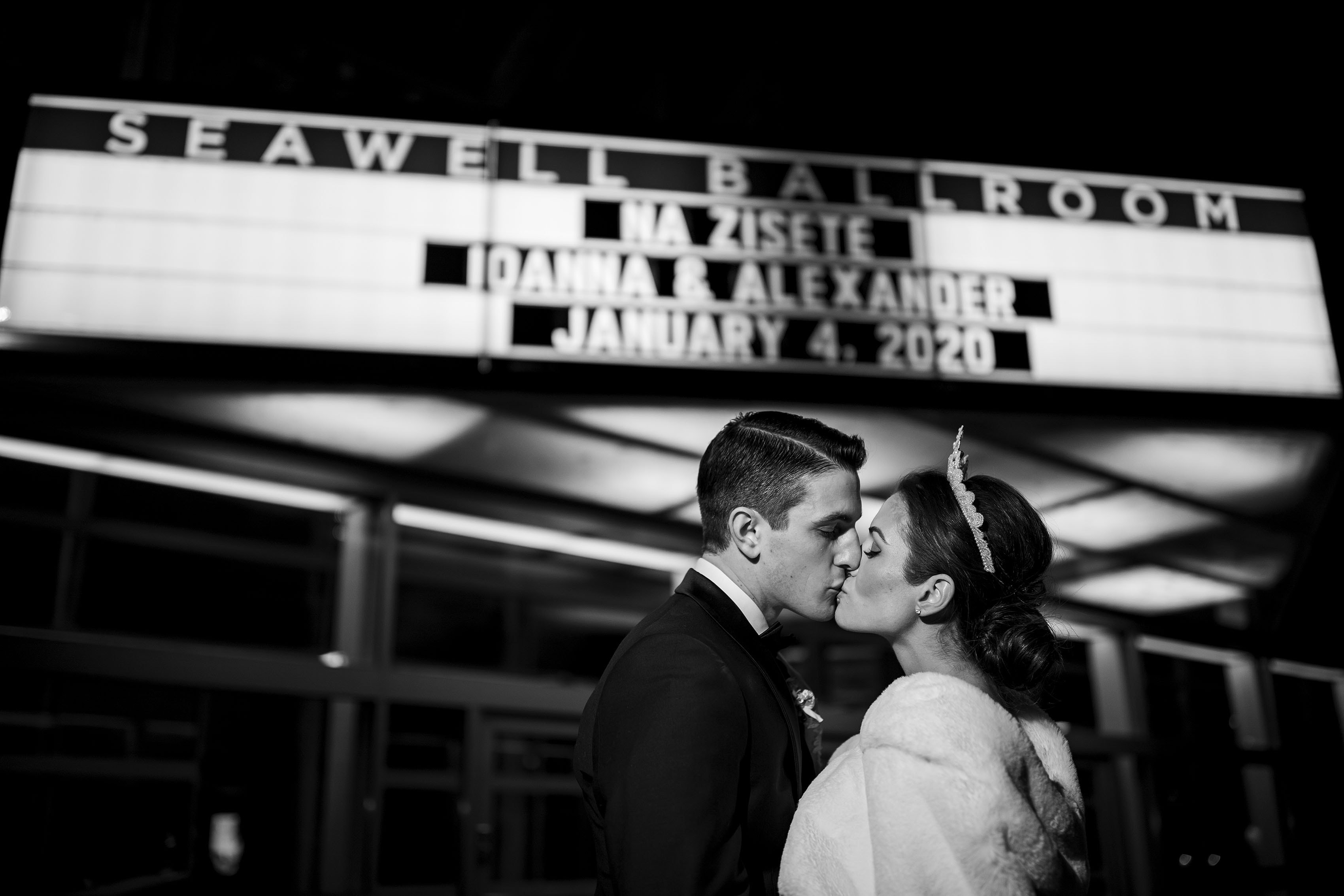Ioanna and Alex share a kiss outside the Seawell Ballroom during wedding at the Denver Center for the Performing Arts in Denver