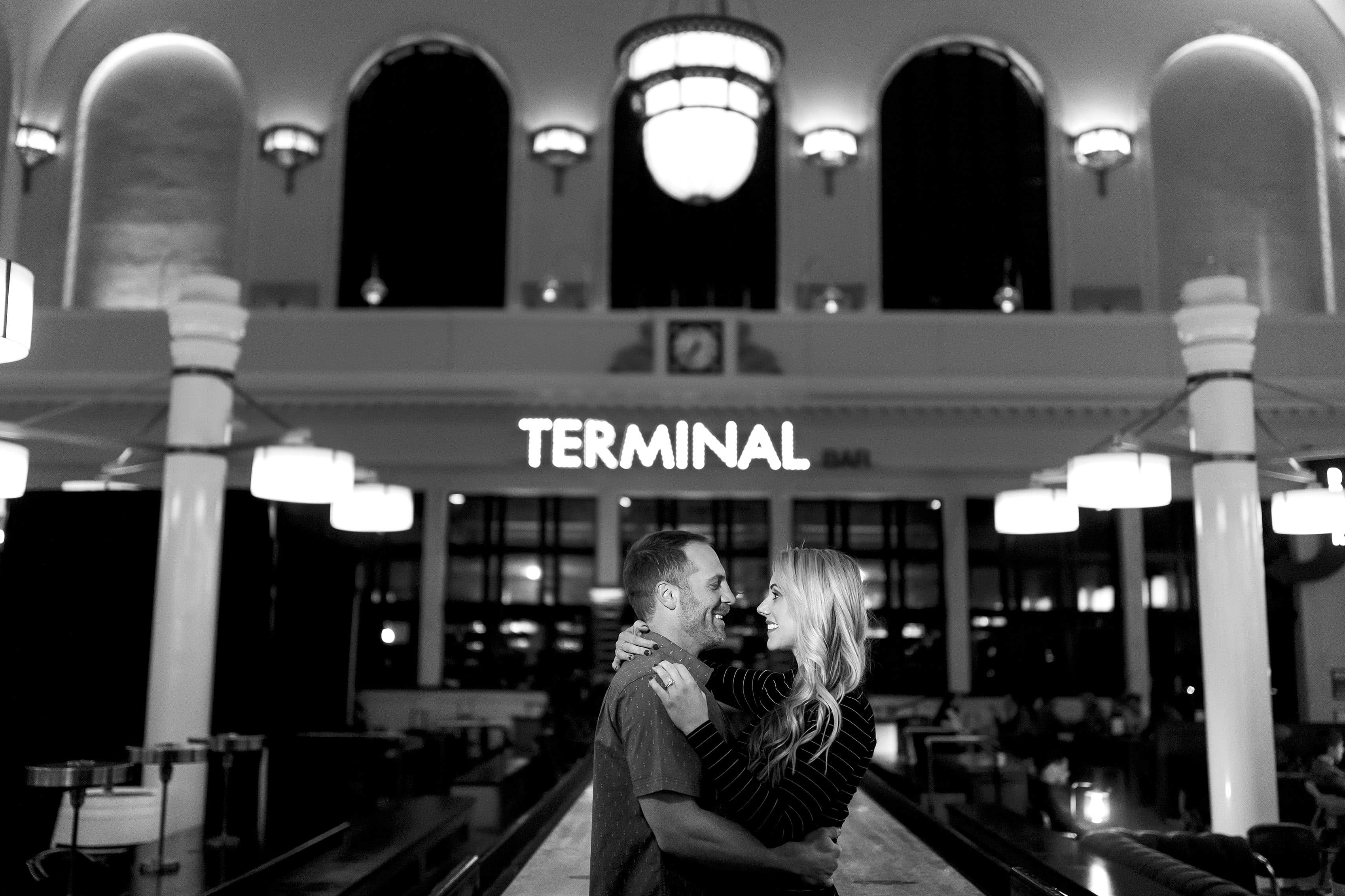 Mesha and Joe share a moment inside Denver's Union Station at the Terminal Bar during their engagement photos