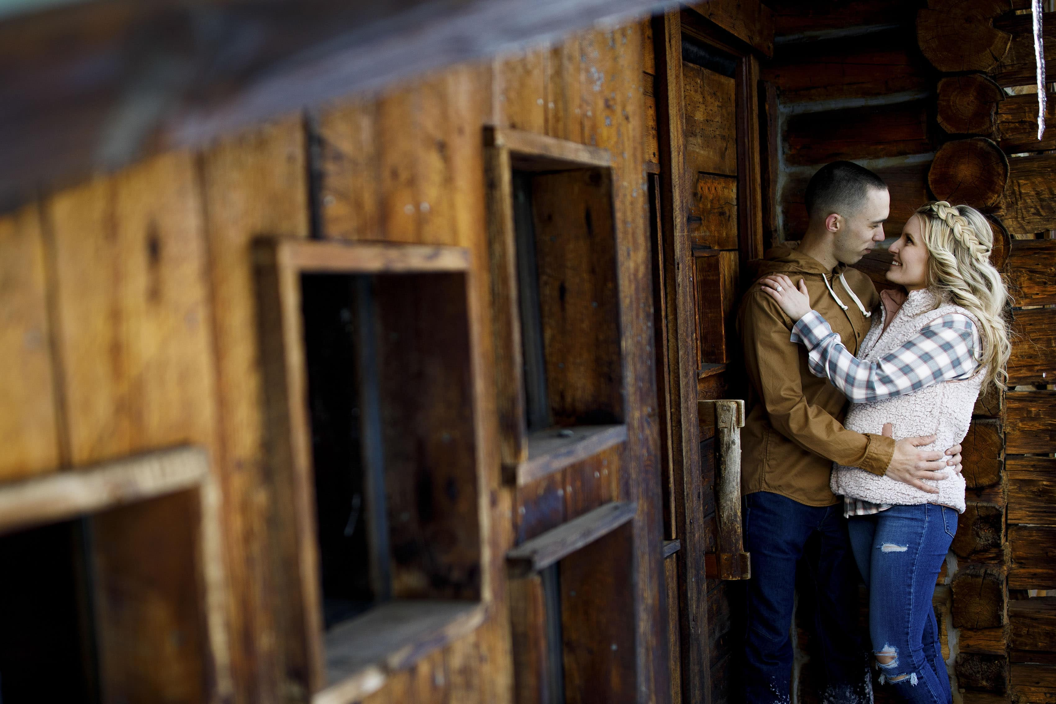 Cassidy and Shane embrace during their Sawmill reservoir engagement photos in Breckenridge