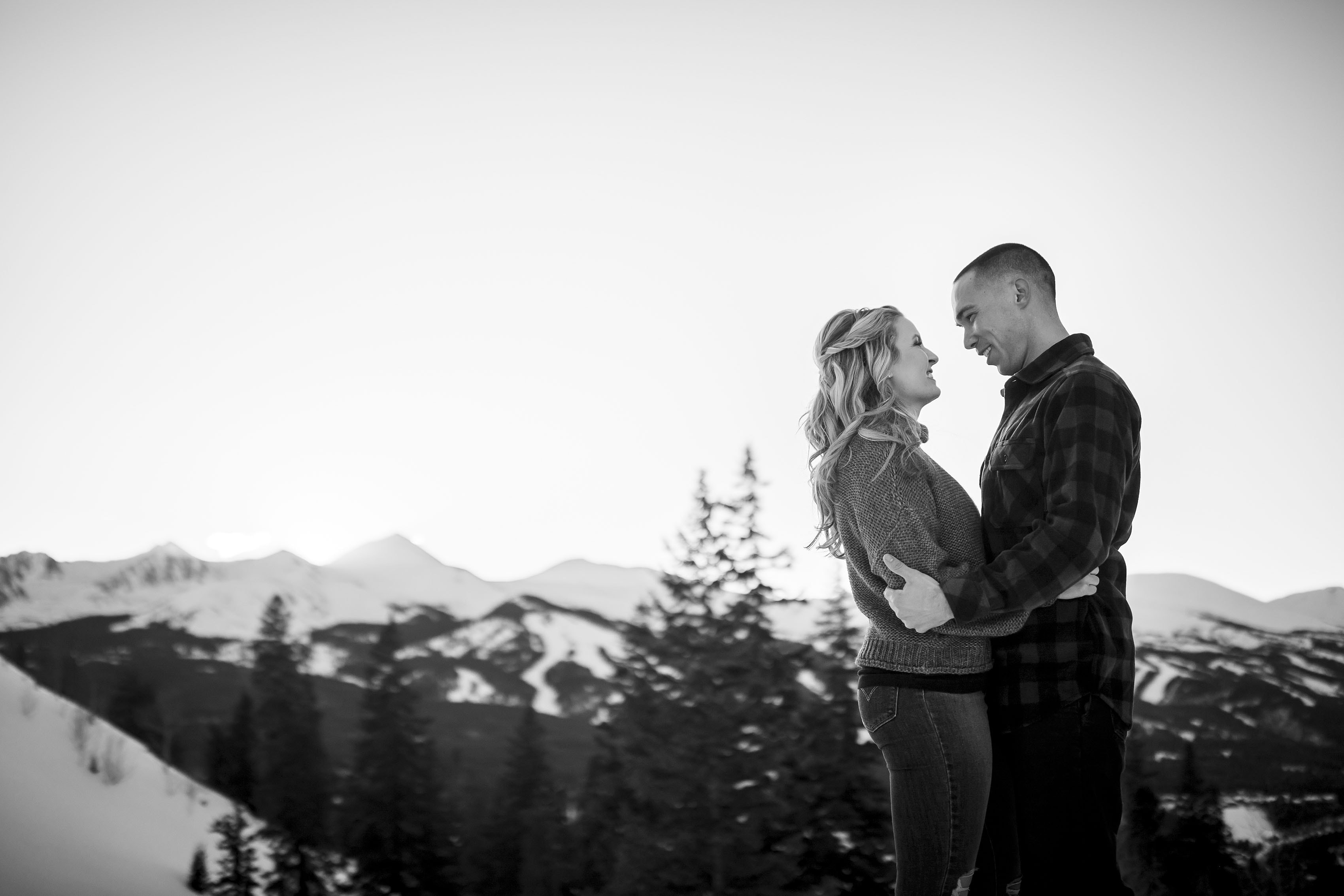 The sun sets over Peak 8 in Breckenridge during Cassidy and Shane's winter engagement photos