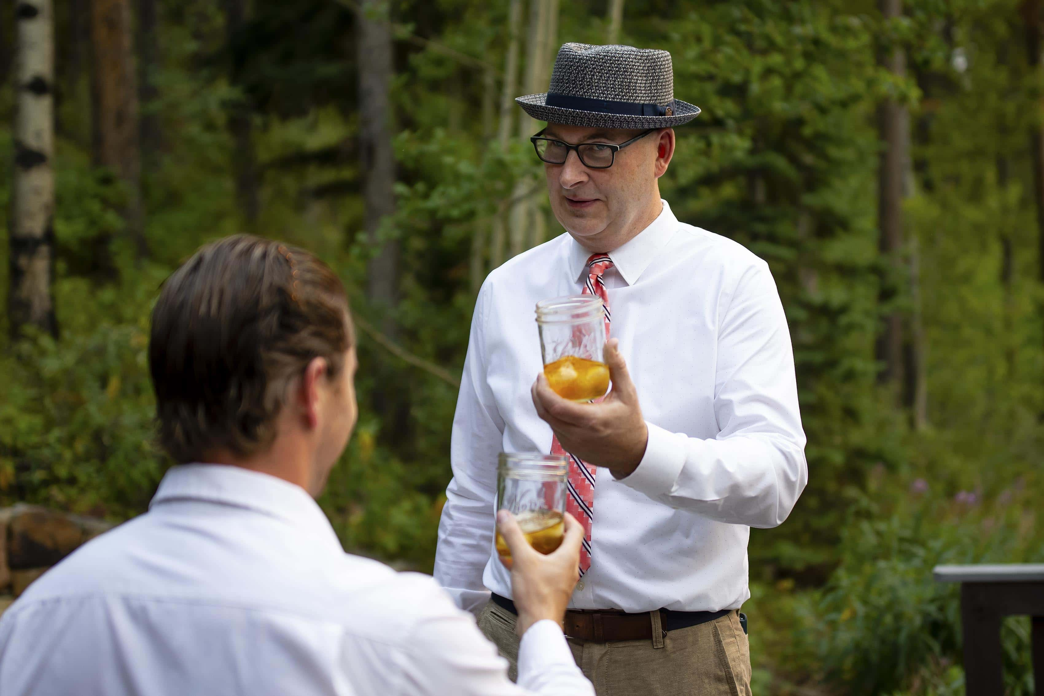 CHris shares a drink with dave prior to his elopement