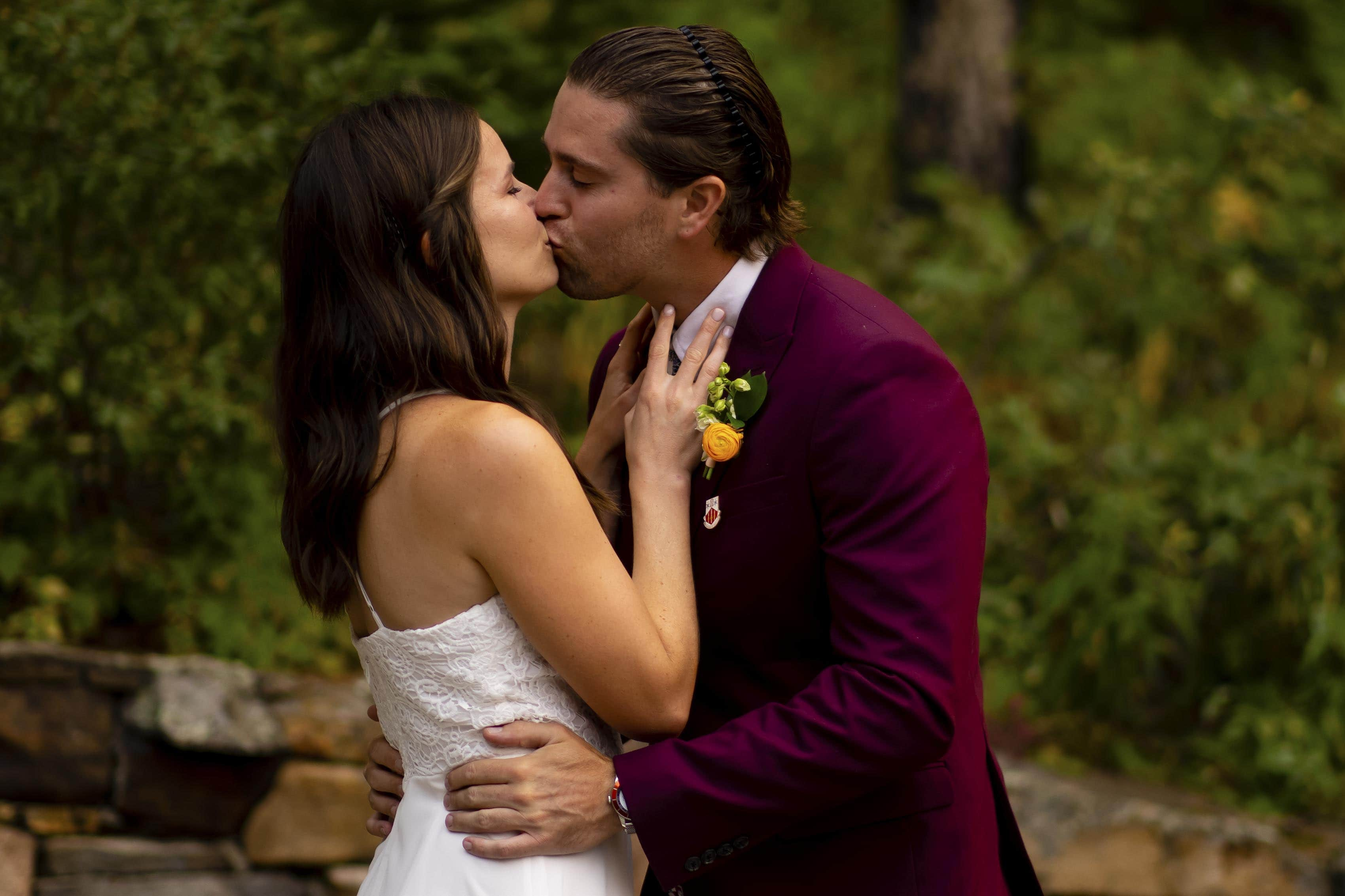 The couple share their first kiss as newlyweds