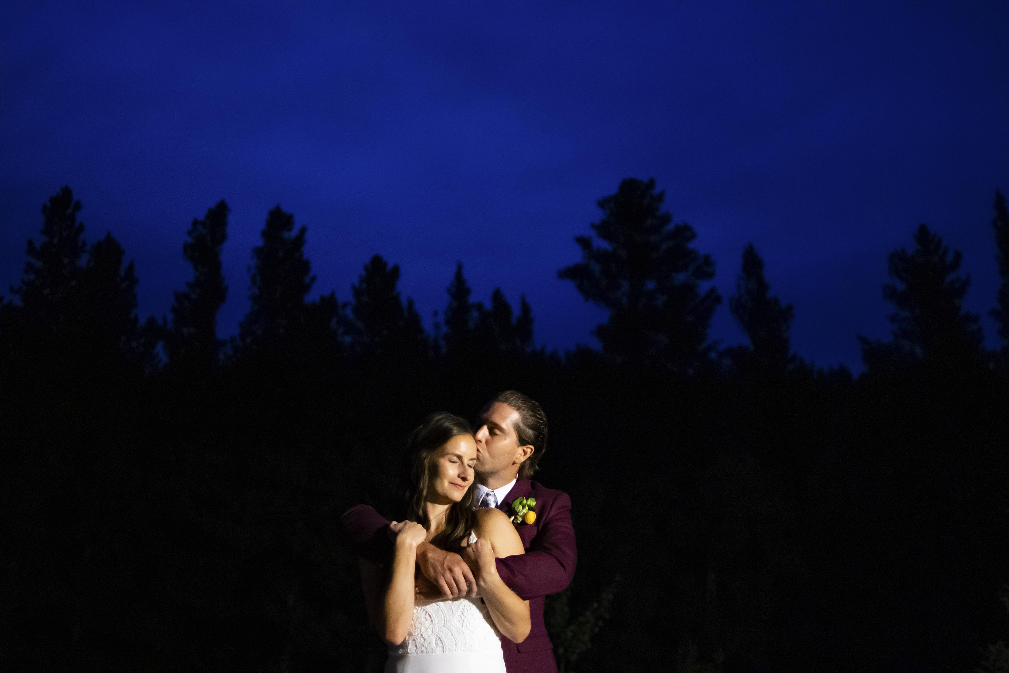 Chris kisses Marla under the twilight sky during their wedding day