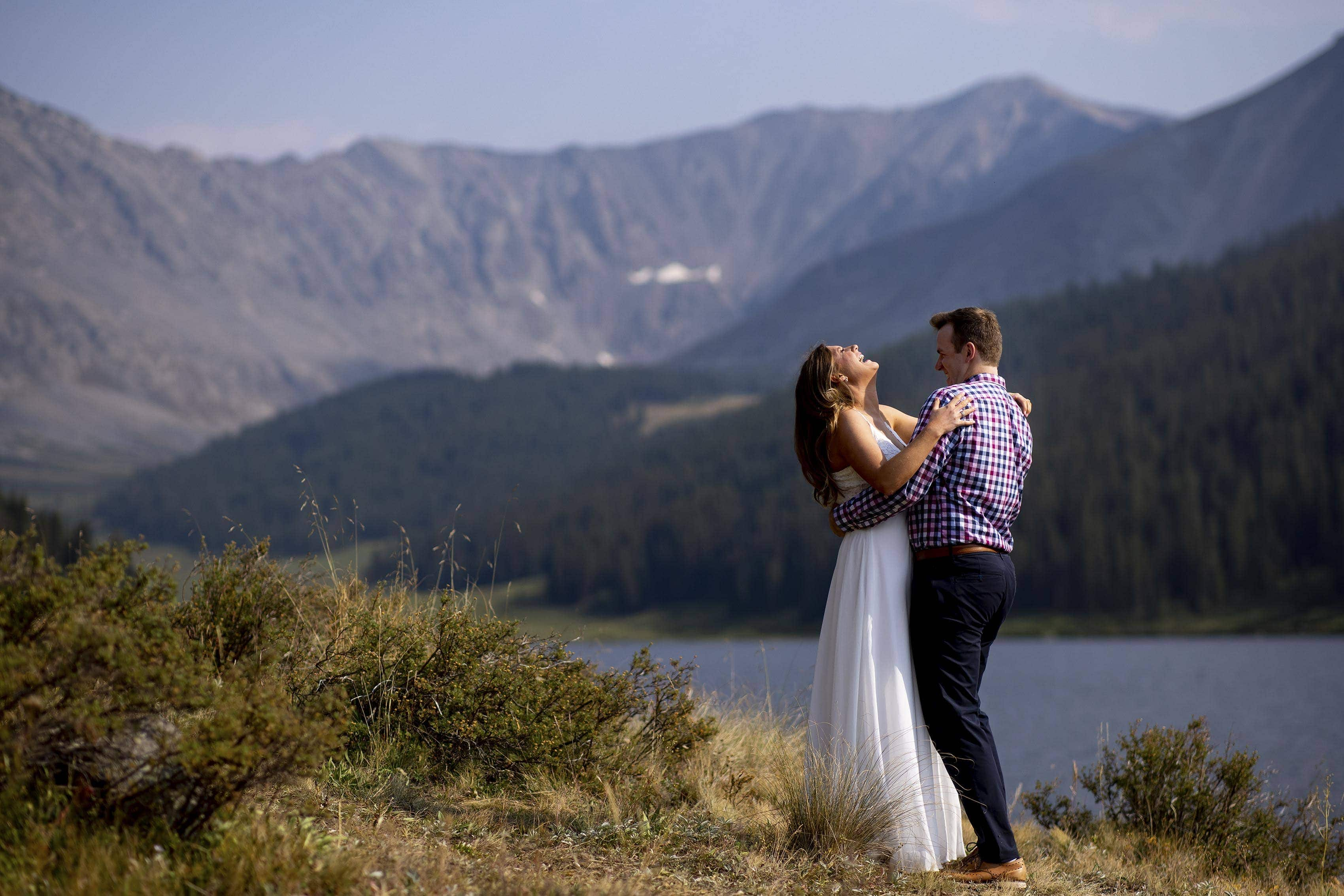 The couple share a laugh at Clinton Gulch Dam Reservoir during their wedding