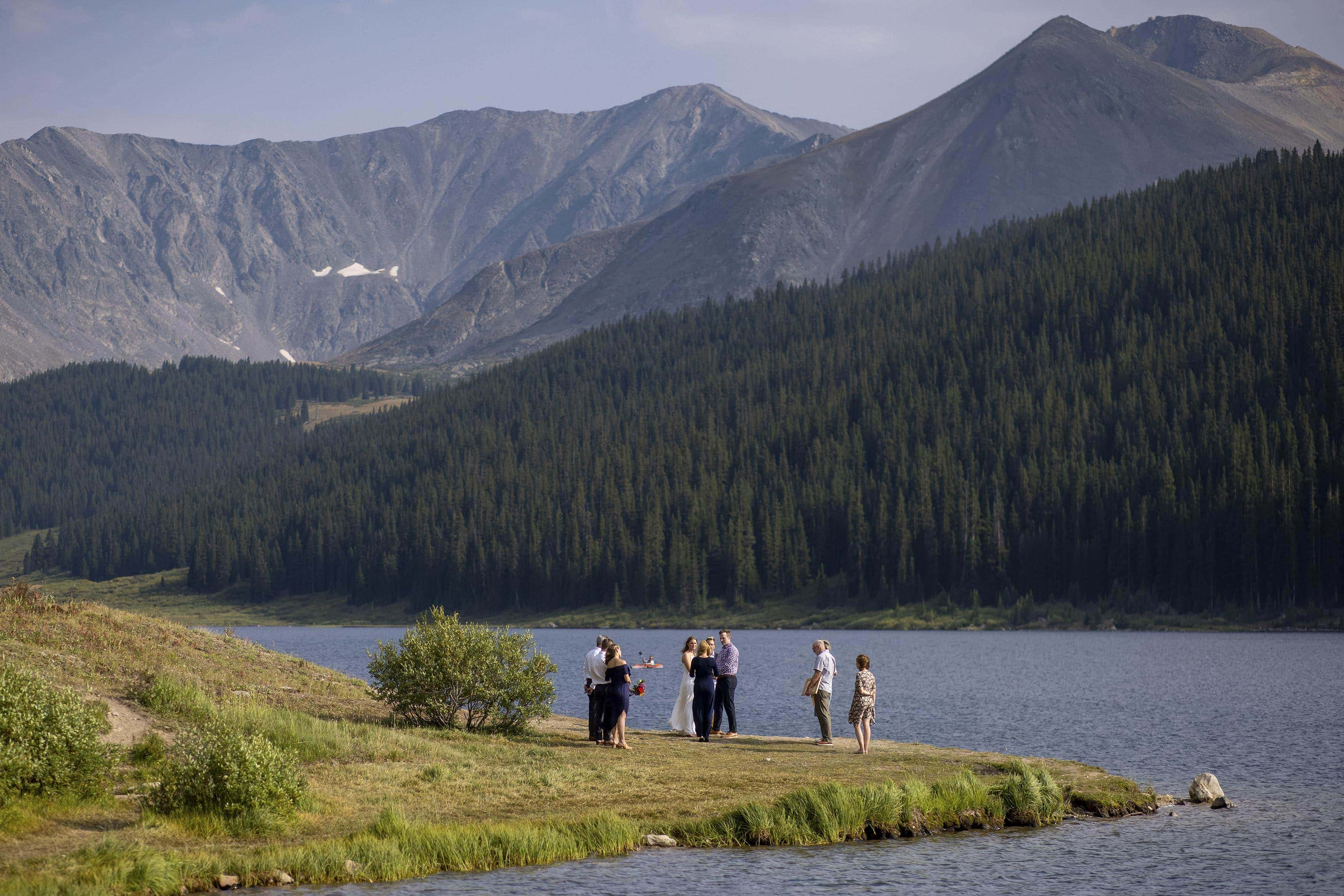 A small wedding ceremony takes place at Clinton Gulch Dam Reservoir near Leadville, CO for Mel and Drew