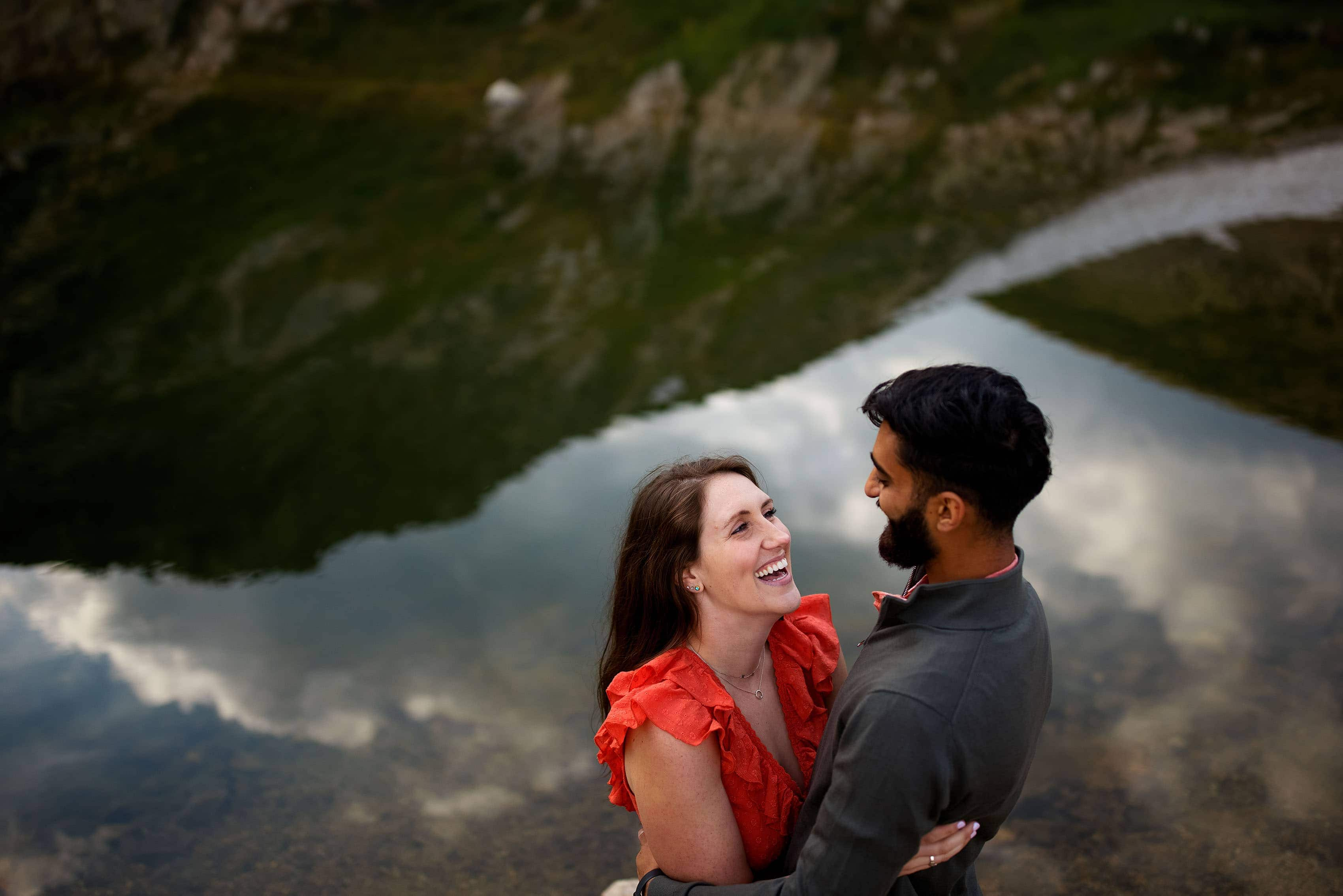 Kara and Moypa share a laugh during their engagement session at St. Mary's Glacier