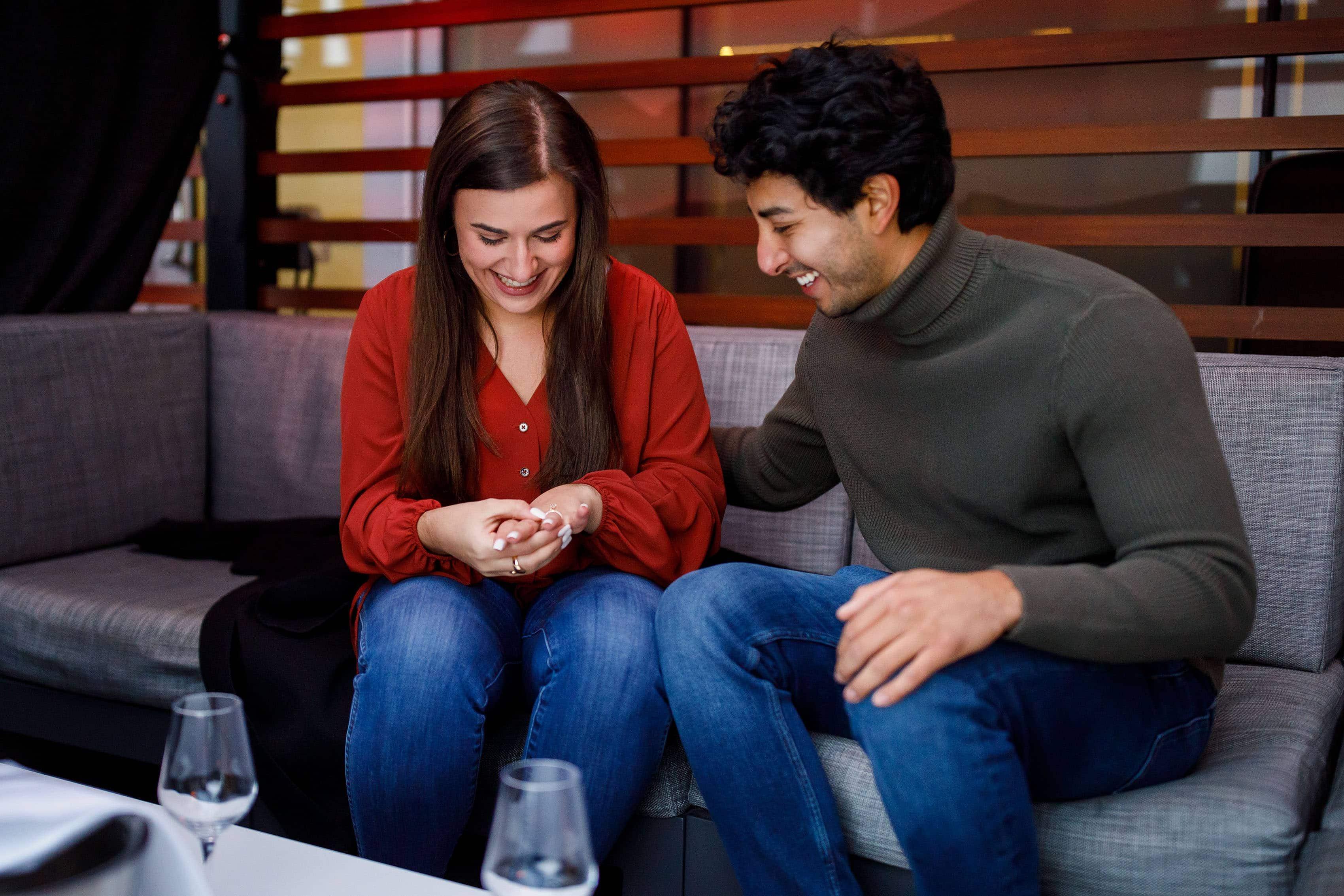Kooper admires her ring after Raul proposed in Denver