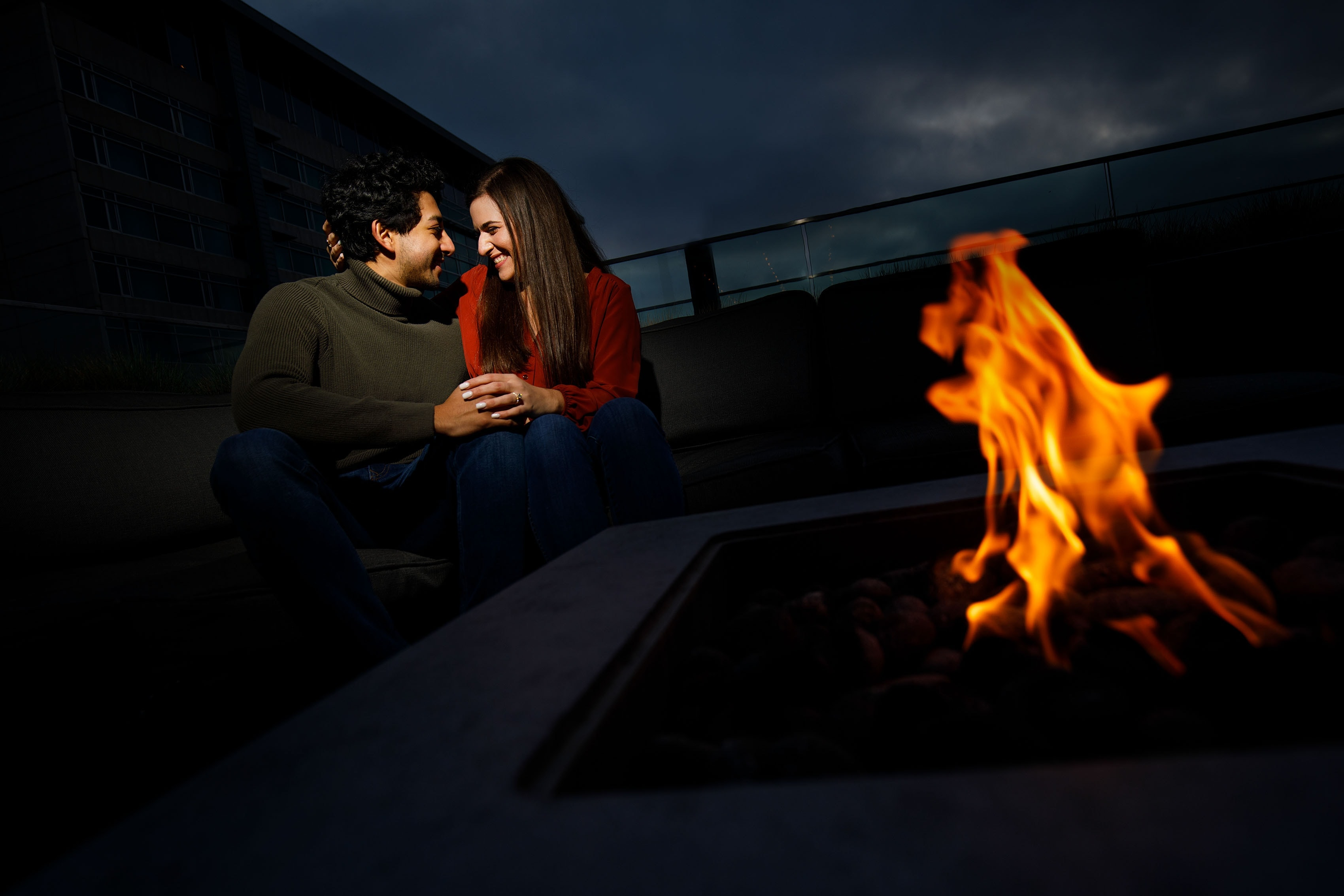 Kooper and Raul share a moment by the fire pit at 54thirty rooftop bar in Denver after their proposal