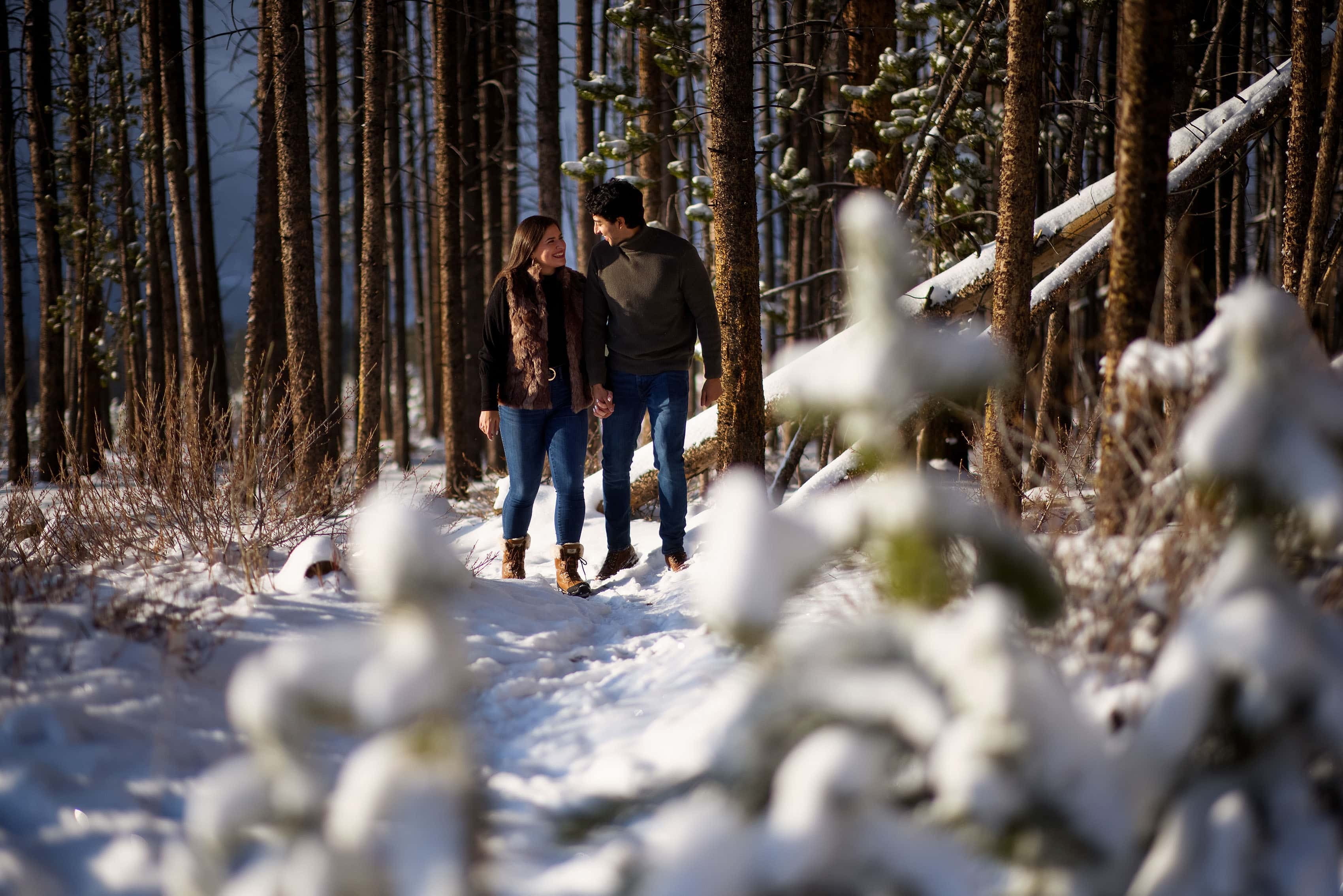 A couple walks together in the snow near Breckenridge