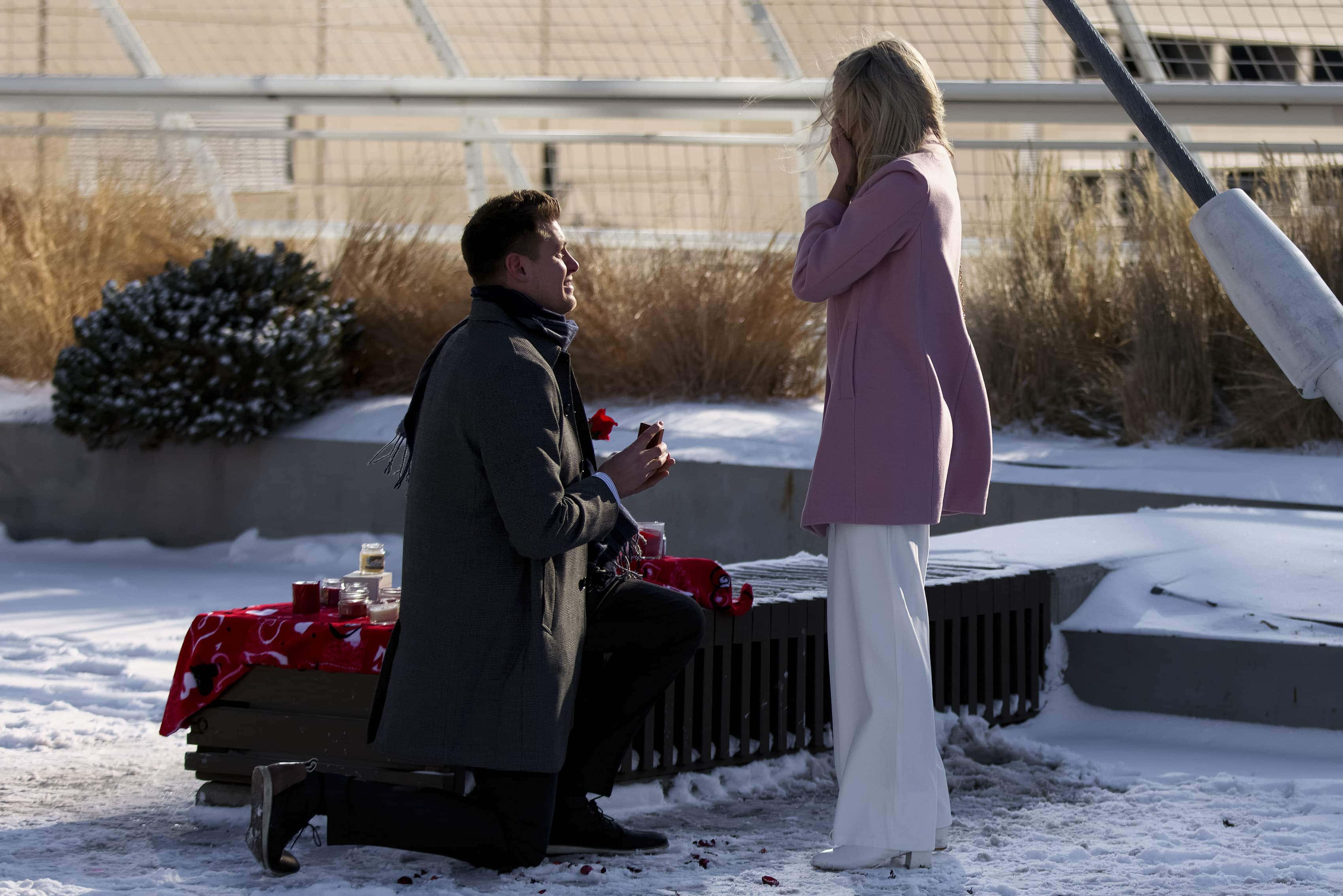 Willy proposes to Kelly on the Denver millennium bridge on Valentines Day