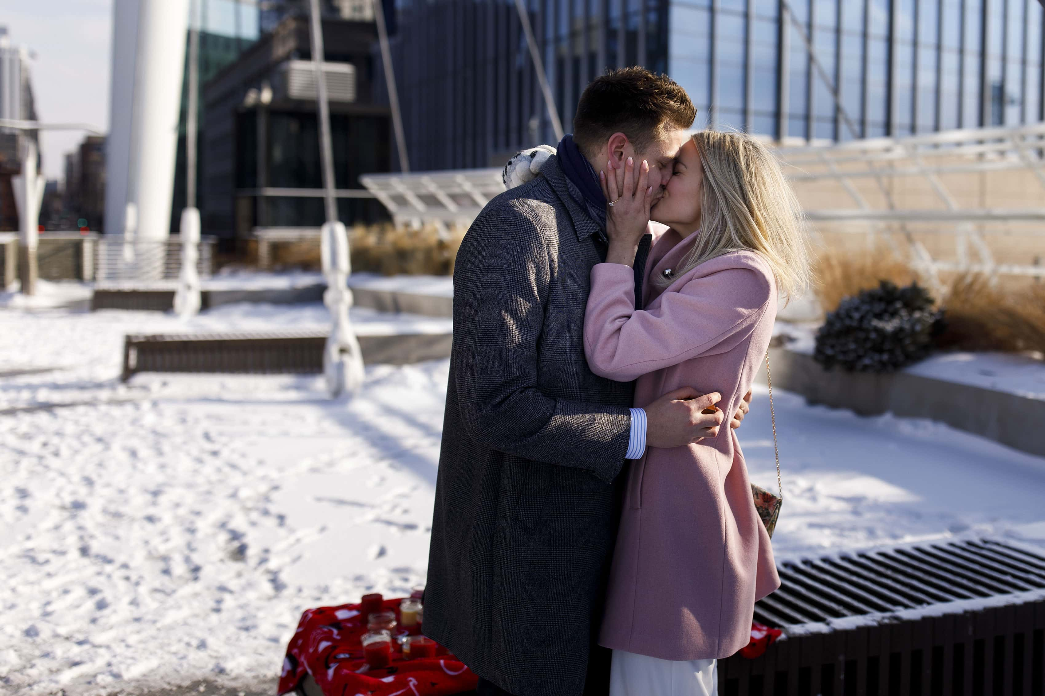 Kelly kisses Willy after he proposed on the Denver millennium bridge on Valentine's Day