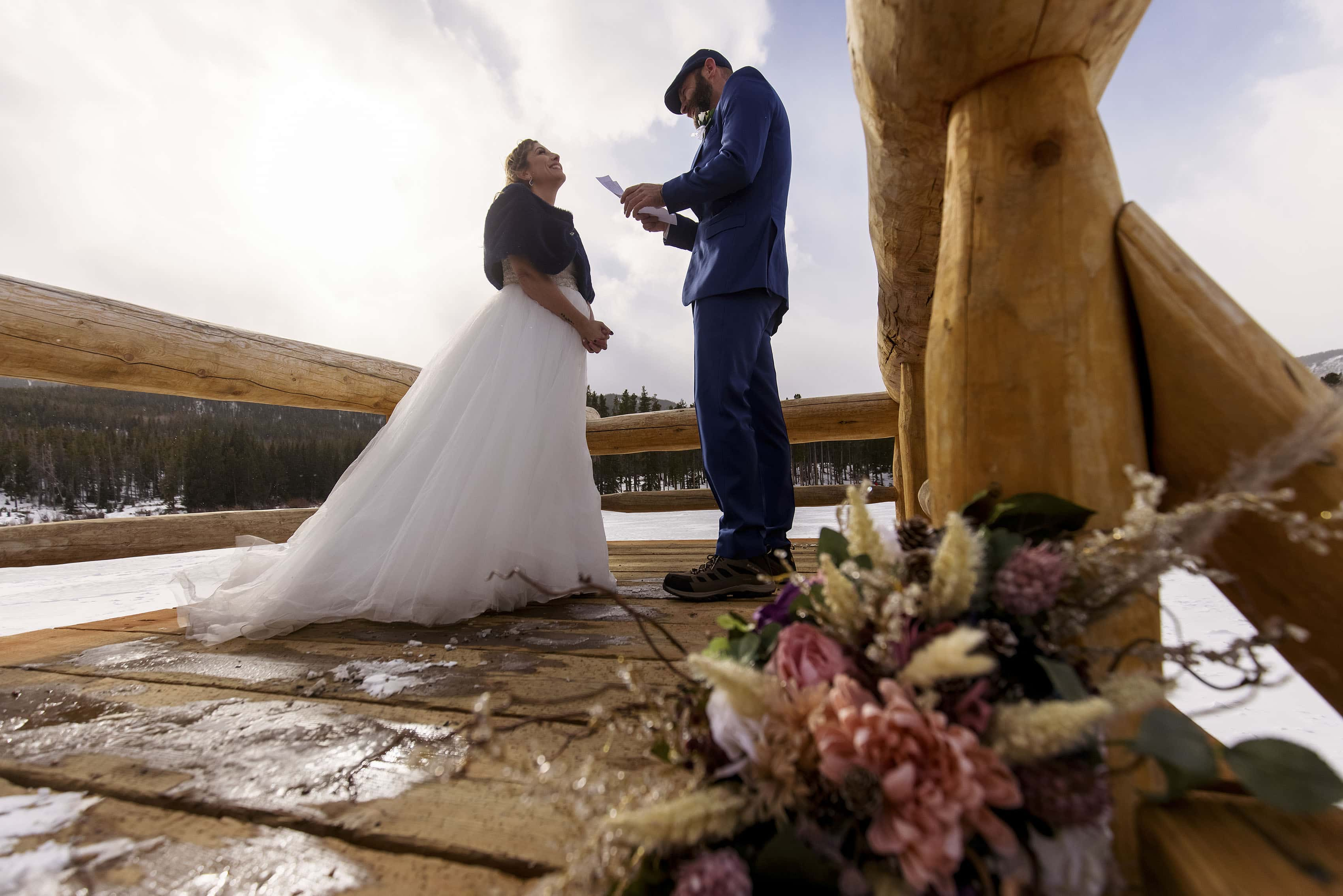 Michell laughs as Mikhail reads his vows during their elopement at Sprague Lake
