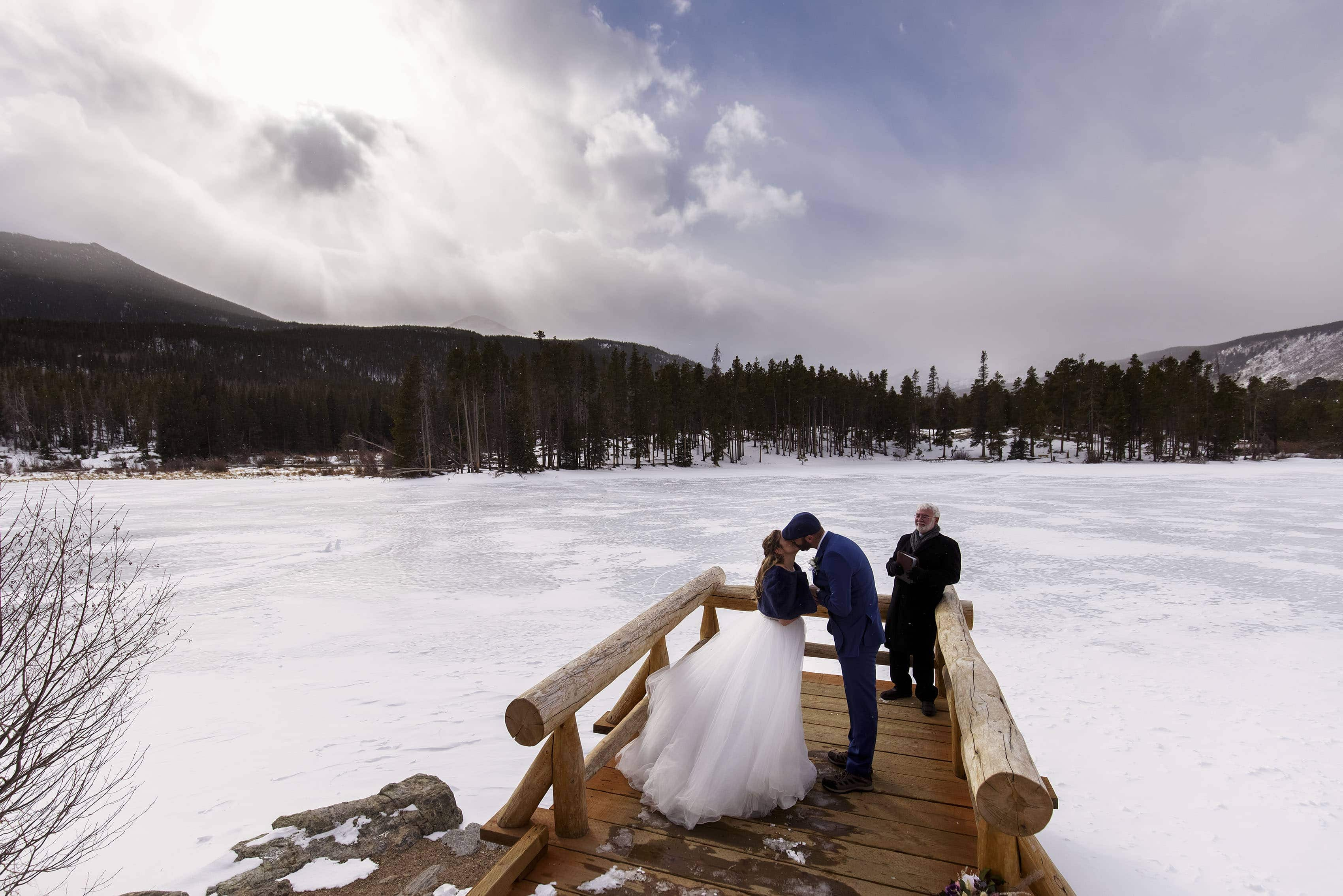 Michell and Mikhail share a kiss during their winter elopement at Sprague Lake