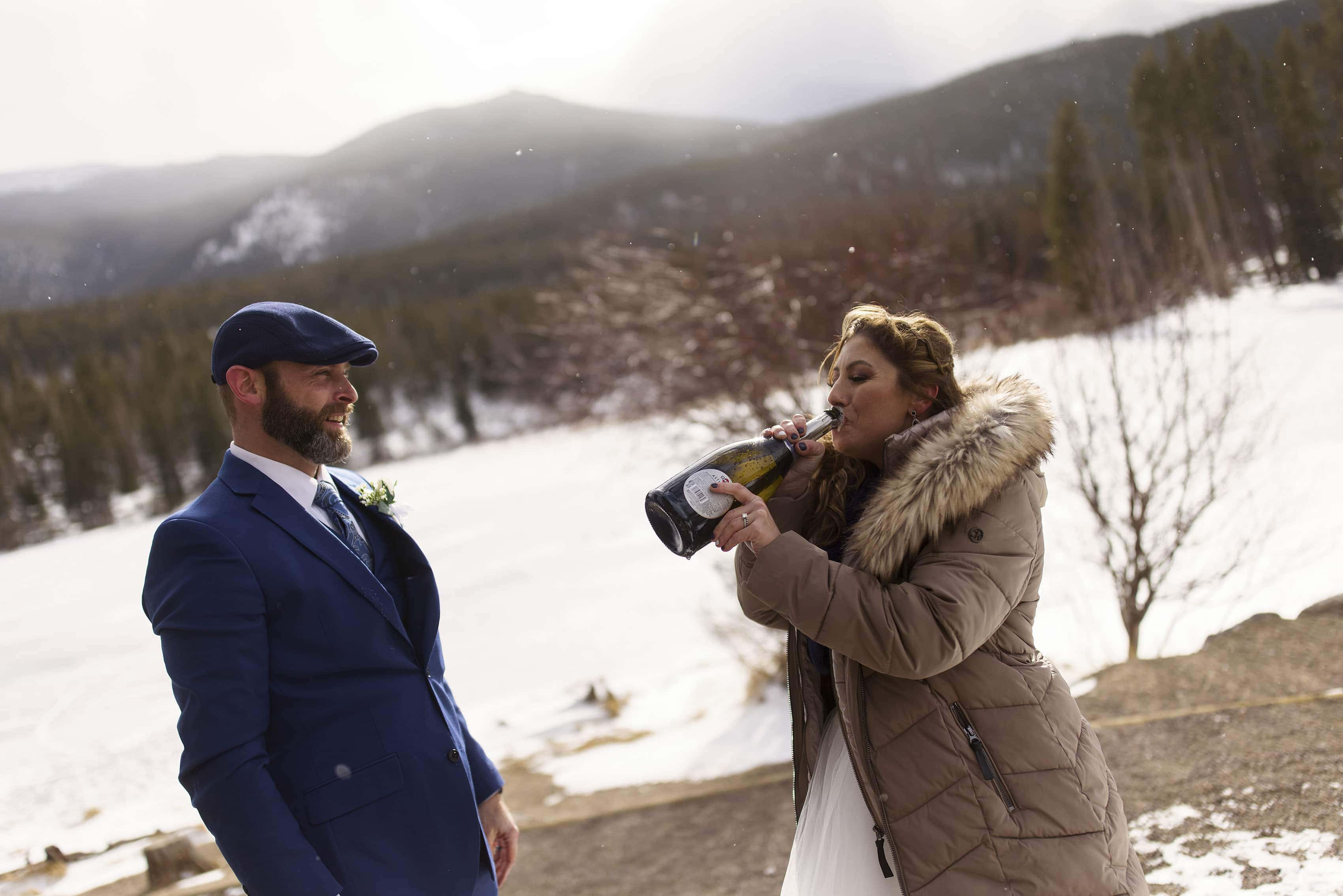 Michell pulls a swig of champagne during her elopement in Rocky Mountain National Park