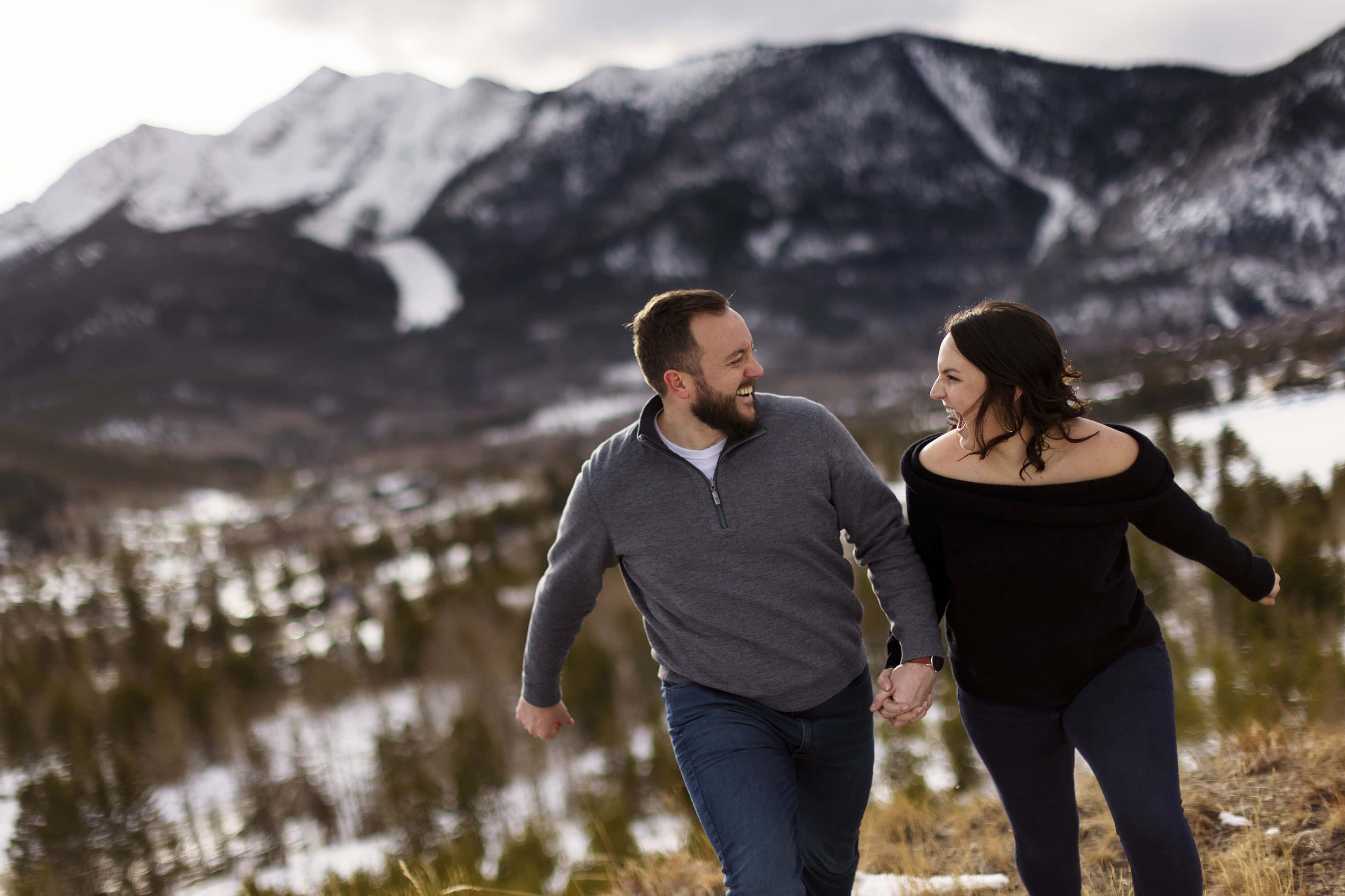Bethany and Nick laugh together during their engagement photos in Frisco, Colorado