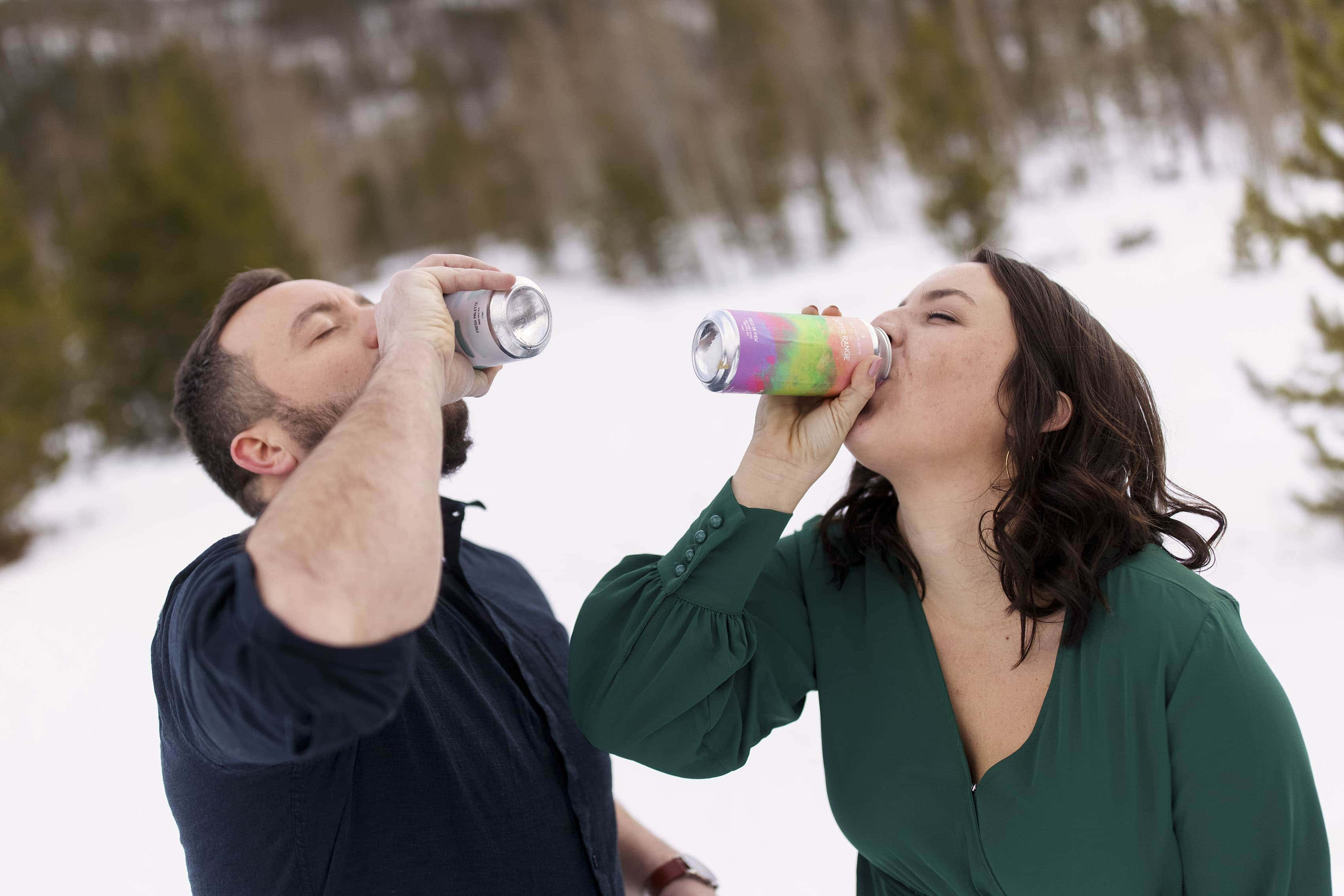 Bethany and Nick enjoy beers from Outer Range Brewing during their engagement session in Frisco, Colorado